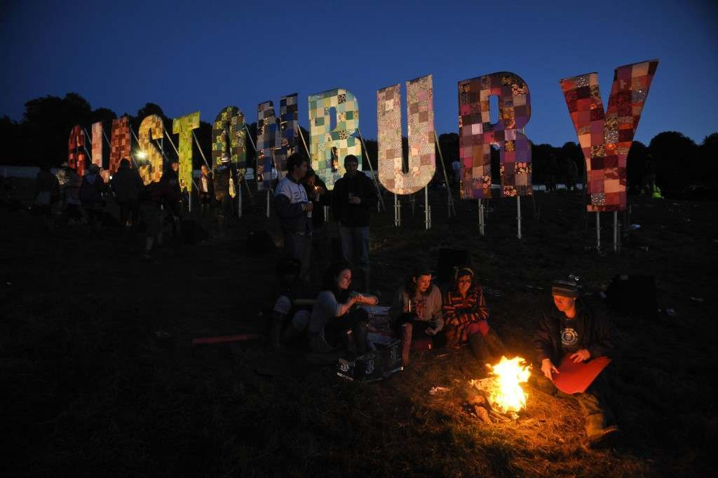 Revellers light a fire after sunset near the Park area at Glastonbury music festival at Worthy Farm, Pilton.  24/06/2011 Picture by: Ben Birchall/PA Archive/Press Association Images Image Size: 4256x2832