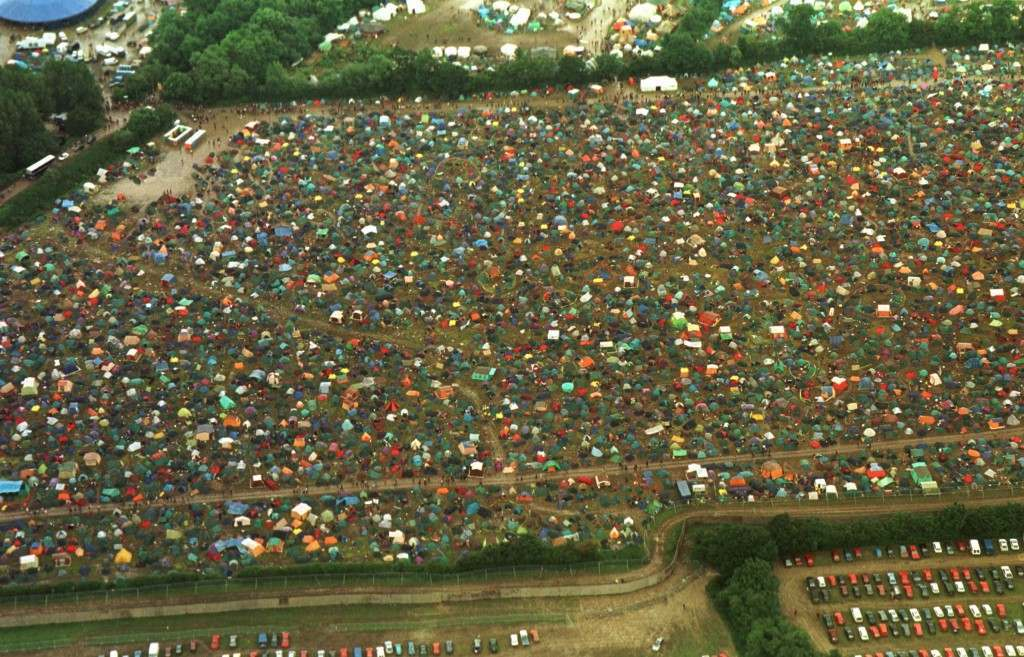Aerial picture showing the Glastonbury Festival today (Saturday) which has been dogged by torrential rain leading to a stream of injuries. PA Photos. See PA story SHOWBIZ Glastonbury 27/06/1998 Picture by: PA/PA Archive/Press Association Images Image Size: 2374x1524