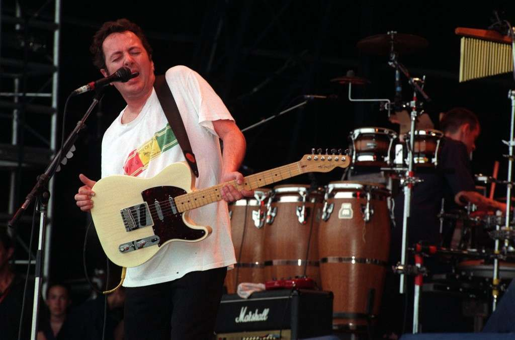 Joe Strummer, formerly of the Clash, performs live on-stage at the Glastonbury Festival. 26/06/1999 Picture by: James Arnold/PA Archive/Press Association Images Image Size: 2240x1480
