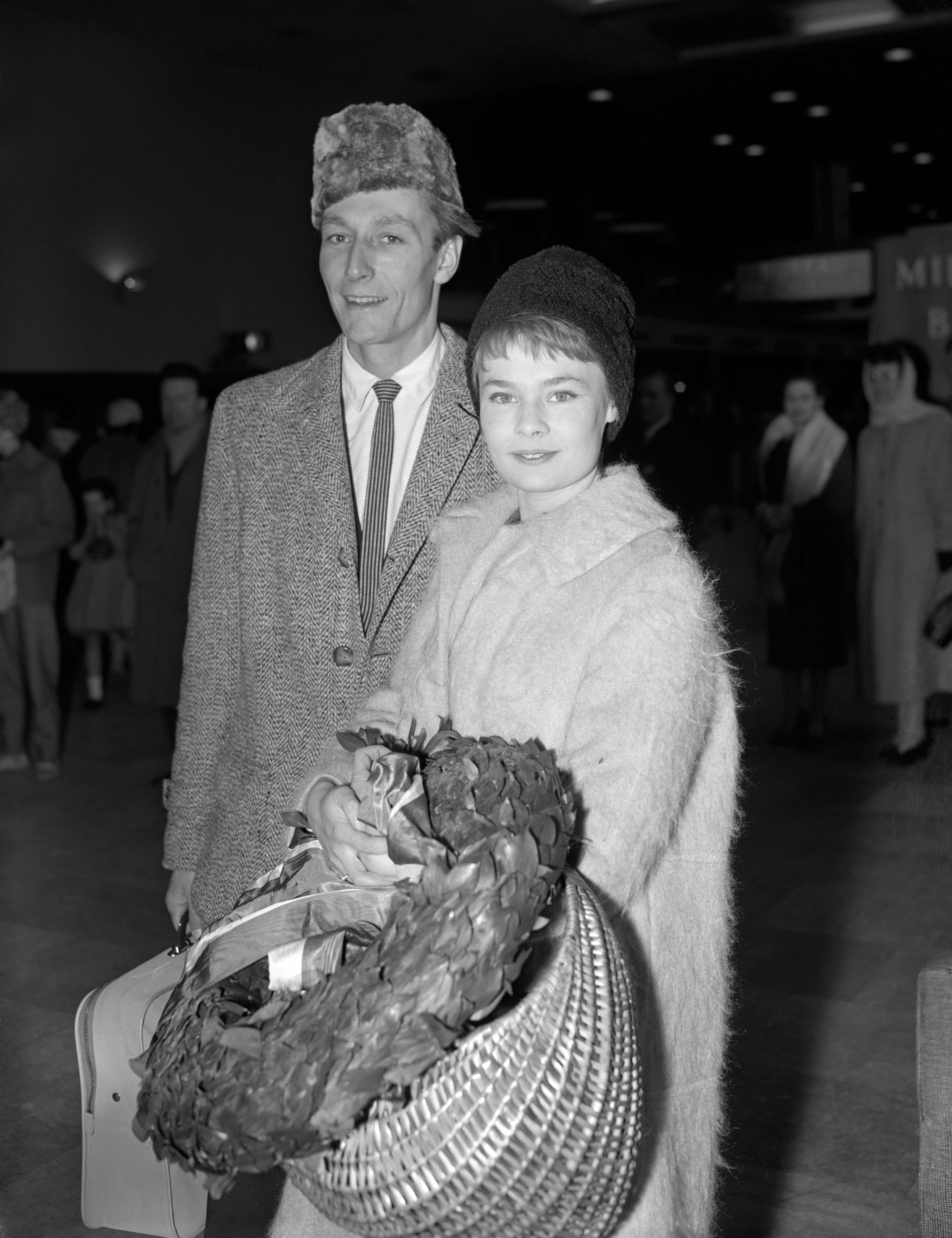 "John Neville (Hamlet) and Judi Dench (Ophelia) at London Airport on their return by BEA charter liner from Jugoslavia with the Old Vic Theatre Company which presented Michael Benthall's production of ""Hamlet"" in Belgrade, Zagreb and Ljubljana. The two week tour was sponsored by the British Council. 29/03/1959"