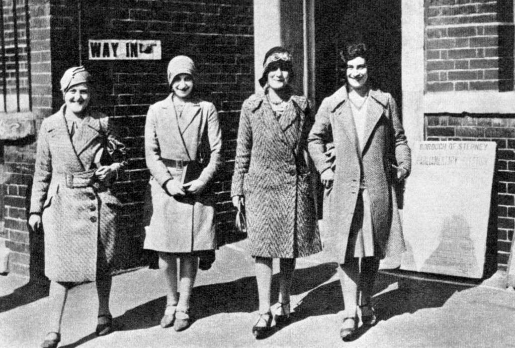 VOTES FOR WOMEN 1929: Universal adult suffrage came to Britain in 1929 and these women, between the ages of 21 and 28, trooped down to the polling station in Stepney, East London, to vote for the first time. Women first gained the vote in time to participate in the 1918 election.