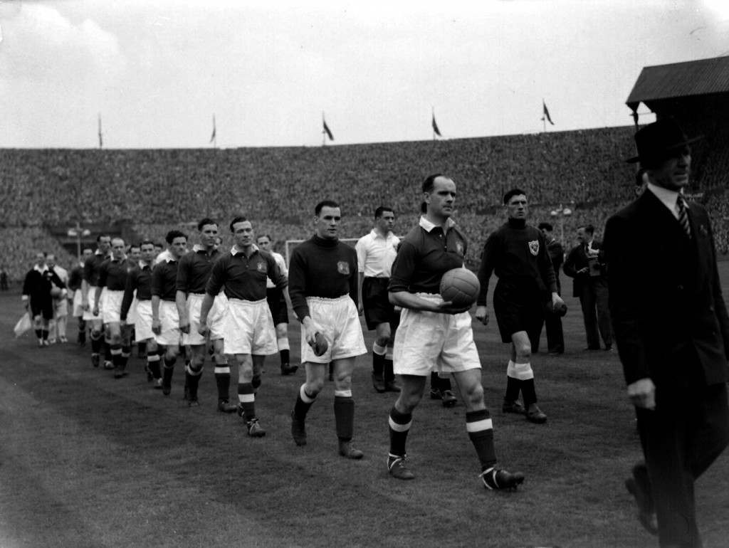 1948: Manchester United, in the Royal Blue shirts, and Blackpool, in the white shirts, come out onto the field at the start of the FA Cup Final at Wembley, London. Ref #: PA.1395432  Date: 24/04/1948