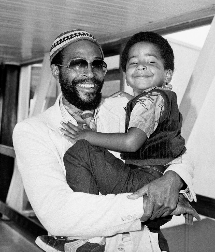 Motown recording star, Marvin Gaye, holding his happy looking four year old son Frankie, on their arrival at London's Heathrow airport from San Francisco. Marvin is here for a British and European concert tour starting at London's Royal Albert Hall. Date: 12/06/1980