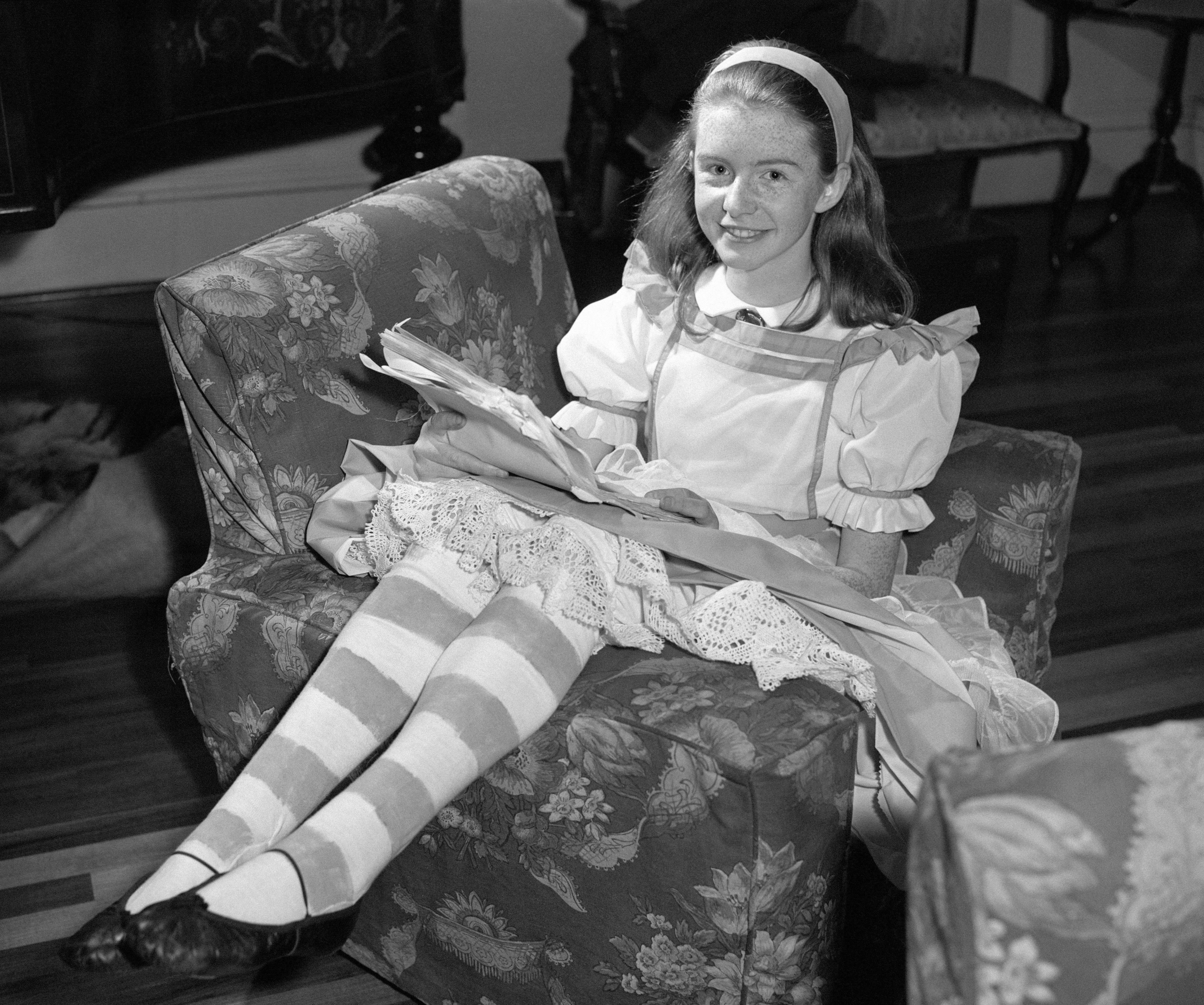 Jane Asher, aged 13, is to play Alice in 'Alice In The Looking-Glass,' to be seen at the Playhouse, Oxford Jane is seen in the costume for the part in London. 23/11/1959