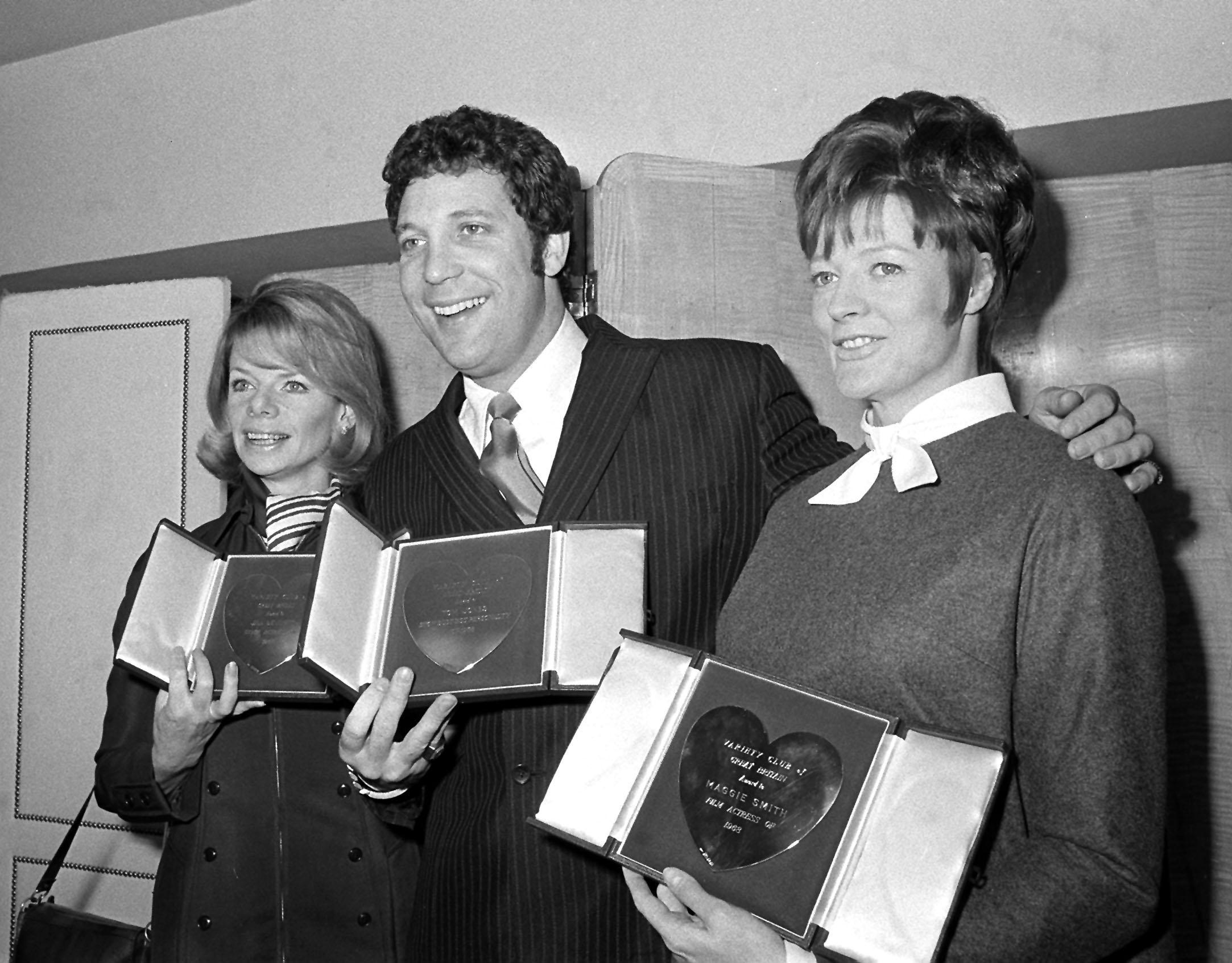 Jill Bennett, Tom Jones and Maggie Smith (left to right) with their mounted and inscribed silver hearts show business awards presented to them by the Variety Club of Great Britain at the Savoy Hotel, London. 11/03/1969