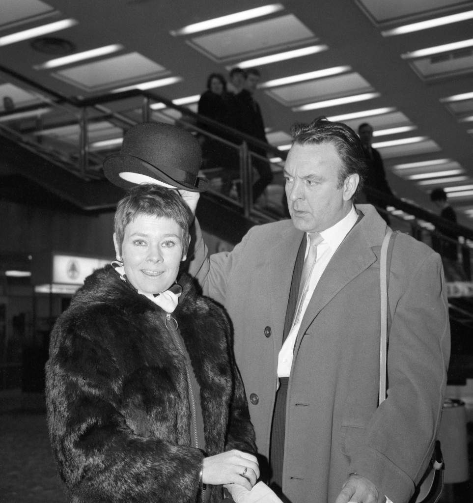 Judi Dench and Donald Sinden at Heathrow Airport, where they were due to embark on a tour of Japan and Australia with the Royal Shakespeare Company. Date: 08/01/1970