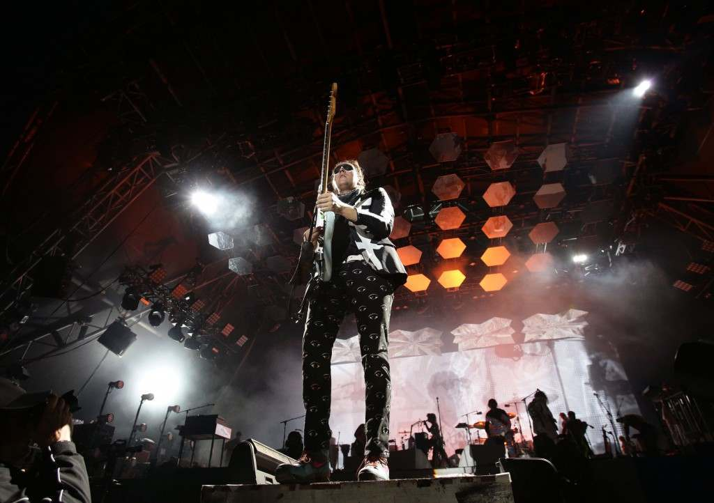 Win Butler of Arcade Fire performing on the Pyramid Stage, at the Glastonbury Festival, at Worthy Farm in Somerset. PRESS ASSOCIATION Photo. Picture date: Friday June 27, 2014. Photo credit should read: Yui Mok/PA Wire