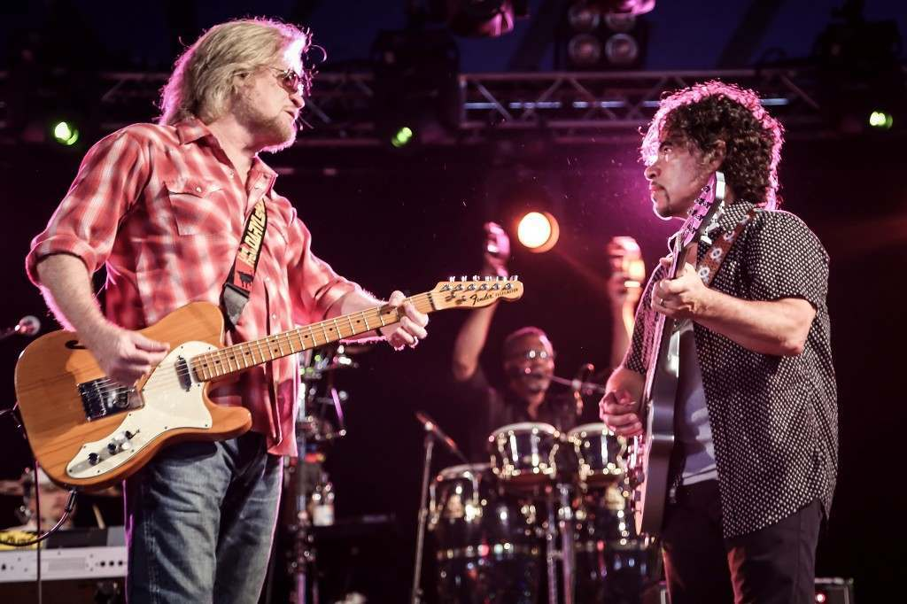 Daryl Hall and John Oates performing live on stage at the 2014 Latitude Festival in Suffolk, England.