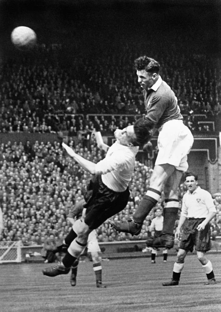 Manchester United's Jack Rowley (r) climbs high to power a header goalwards Ref #: PA.597787