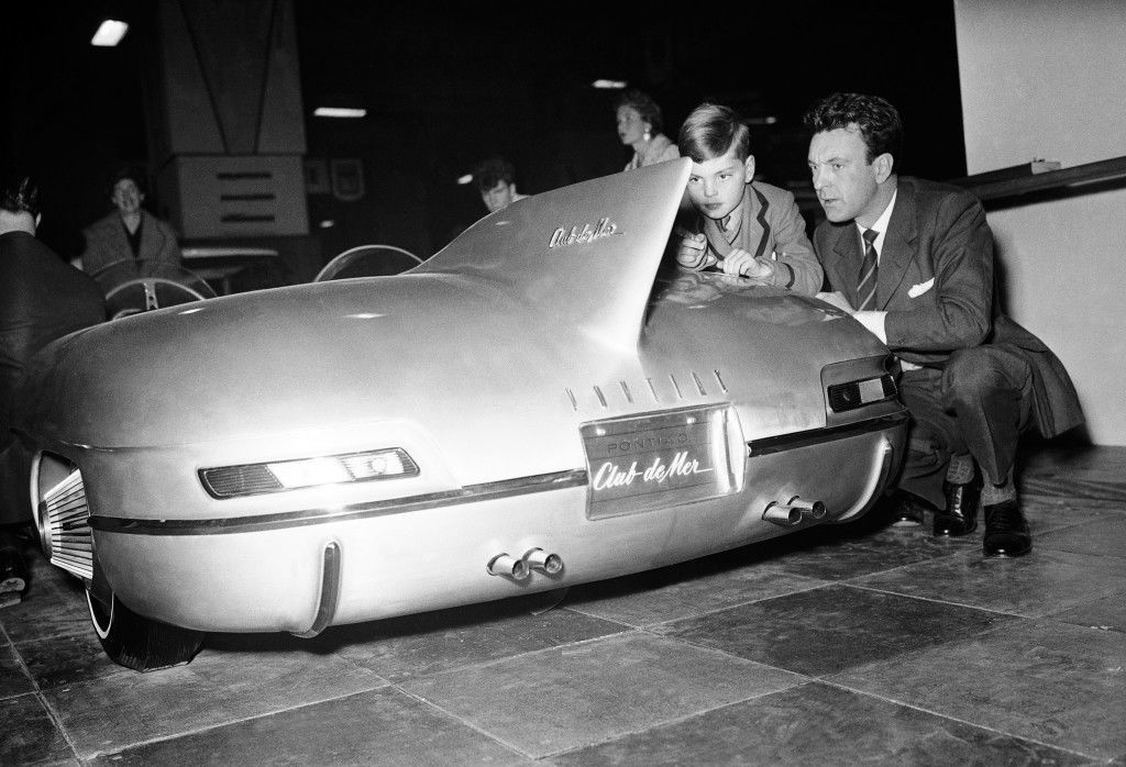 Actor Donald Sinden shows his son Jeremy a Pontiac at the Motor Show at Earls Court. Date: 15/10/1957
