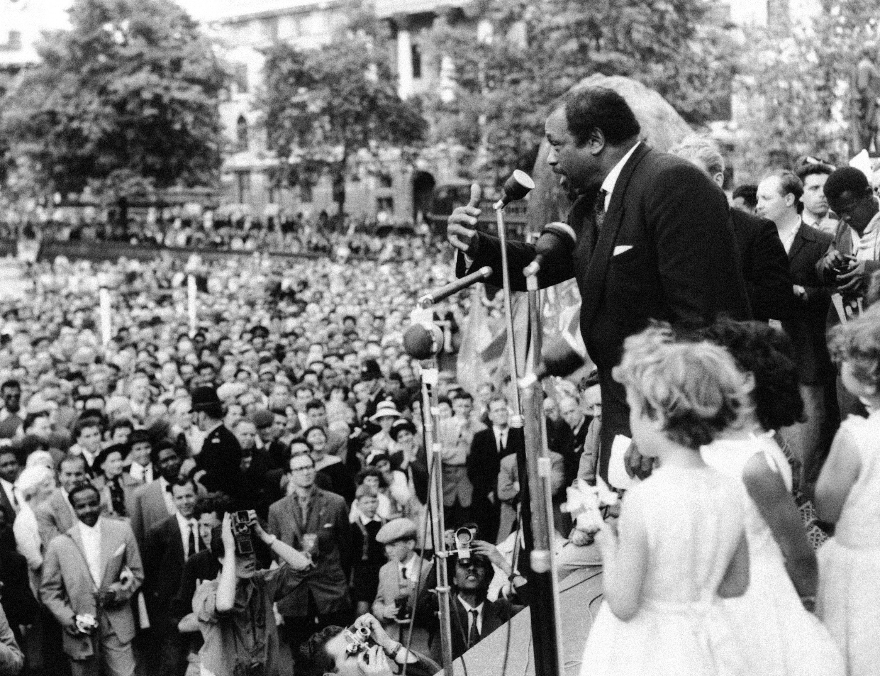 American baritone Paul Robeson speaks to crowd gathered in Trafalgar Square in London, June 28, 1959 to demonstrate against the H-bomb and nuclear weapons. Some 10,000 demonstrators marched to Trafalgar Square from Hyde Park for the rally. The procession was made up of groups and trade unionists and peace organizations and left-wing political groups.
