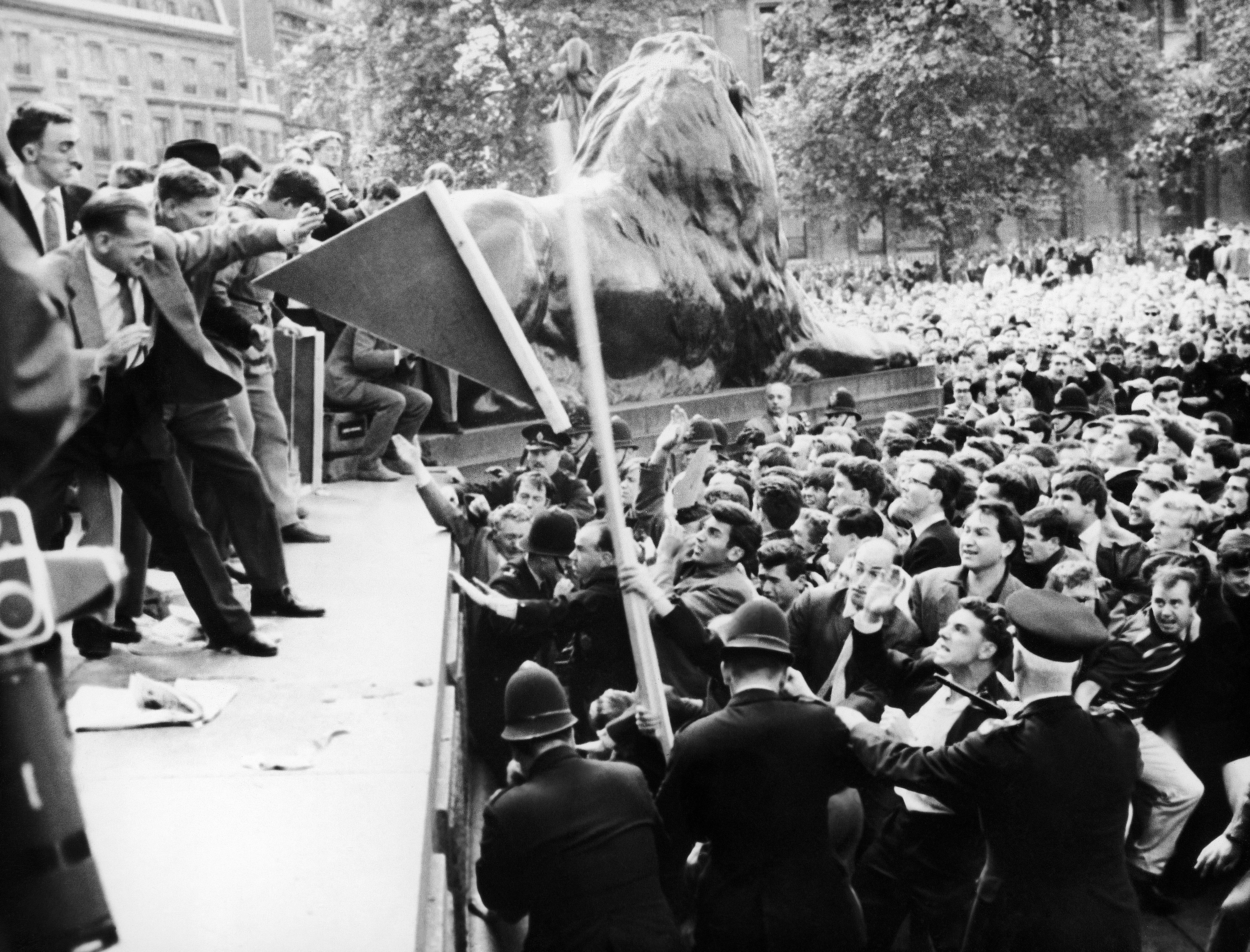 Police spectators and members of the extremist right wing British union movement leader Sir Oswald Mosley unseen clash at Trafalgar Square on July 22, 1962.