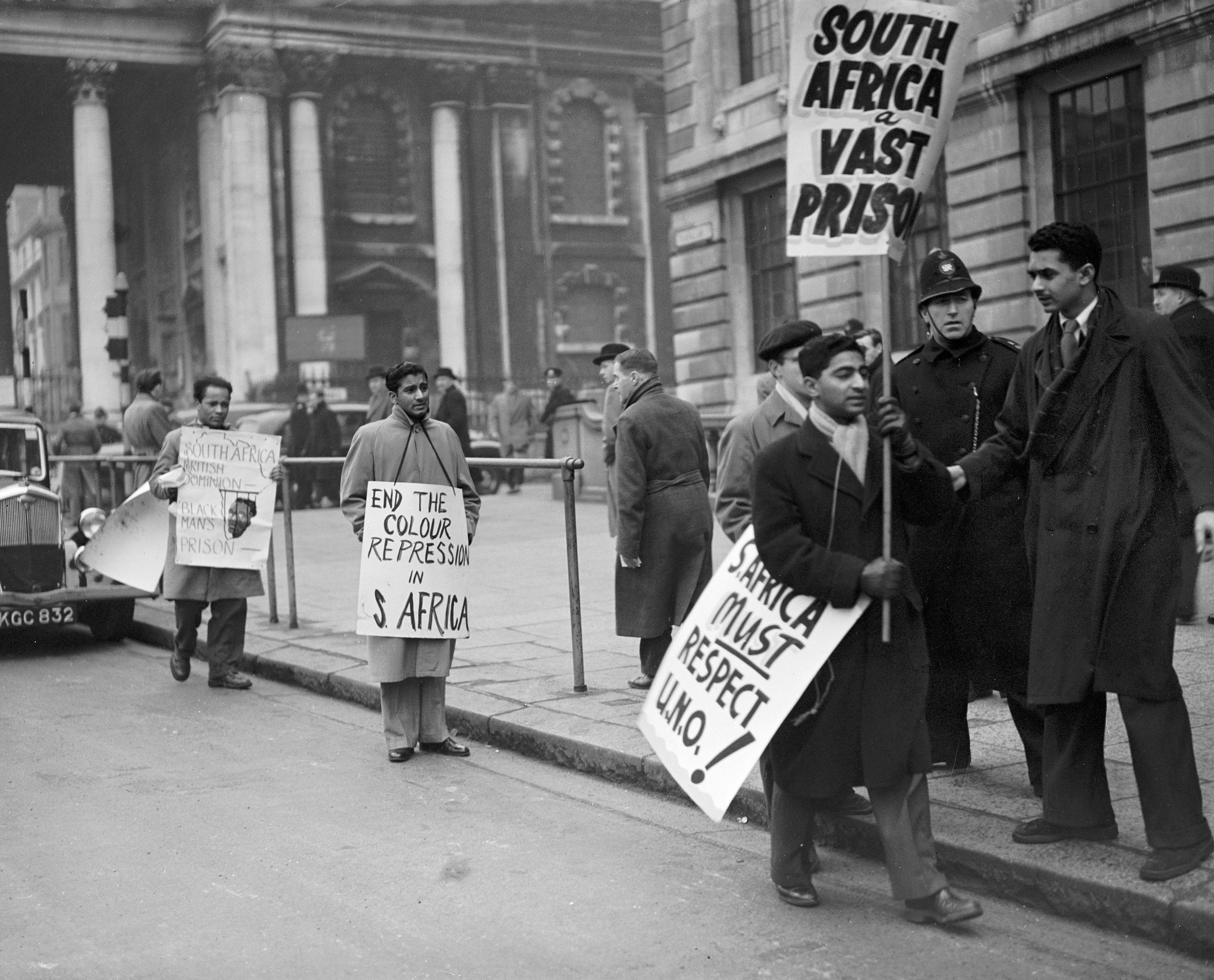 Policemen advise South Africa students, demonstrating in Trafalgar Square, to keep away from the precincts of South Africa House. 10th January 1951.
