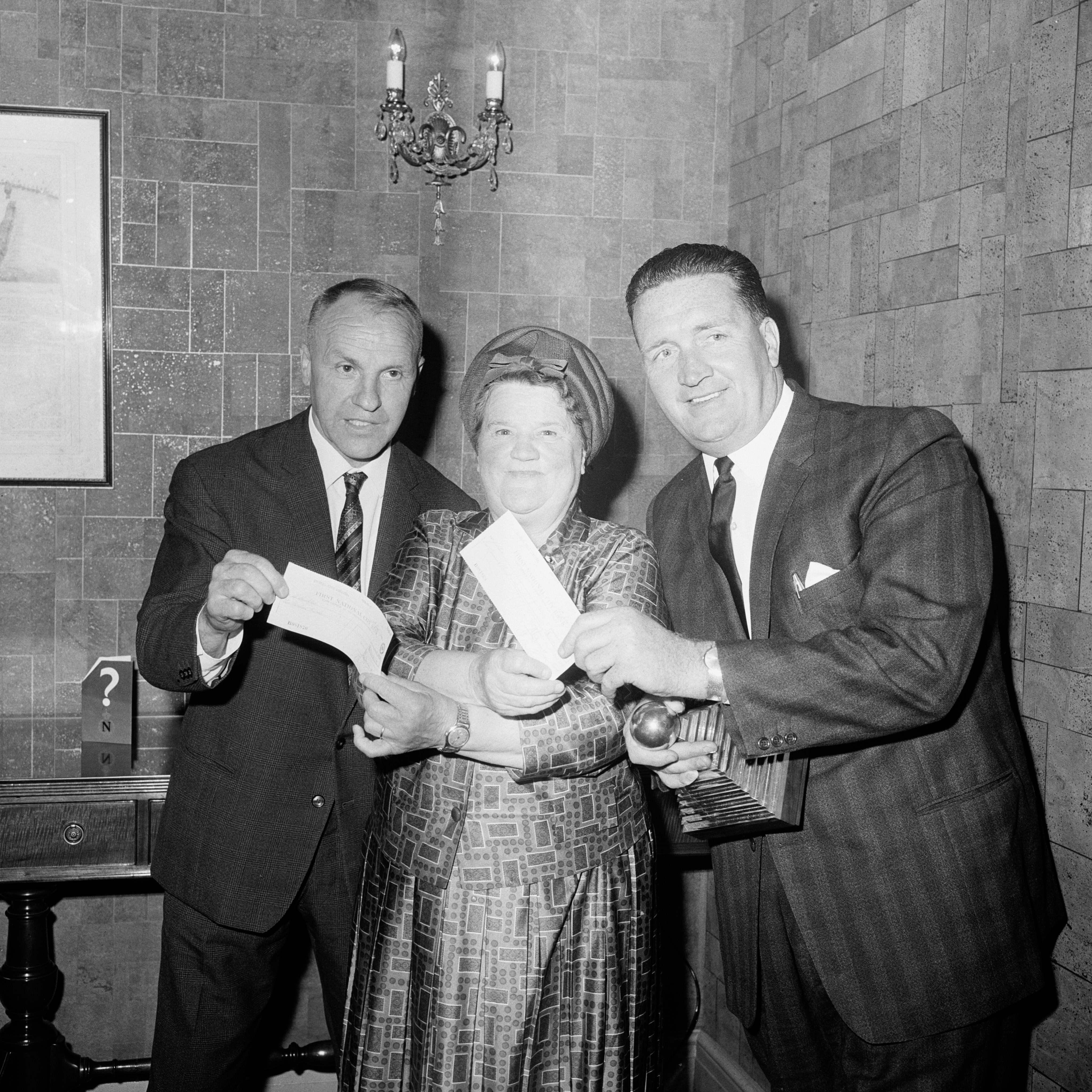 Liverpool Exchange MP Bessie Braddock (c) presents the two winning managers, Liverpool's Bill Shankly (l) and Celtic's Jock Stein (r), with their cheques for £500 and £1000 respectively as Stein holds onto his Manager of the Year trophy. 16/6/1966.