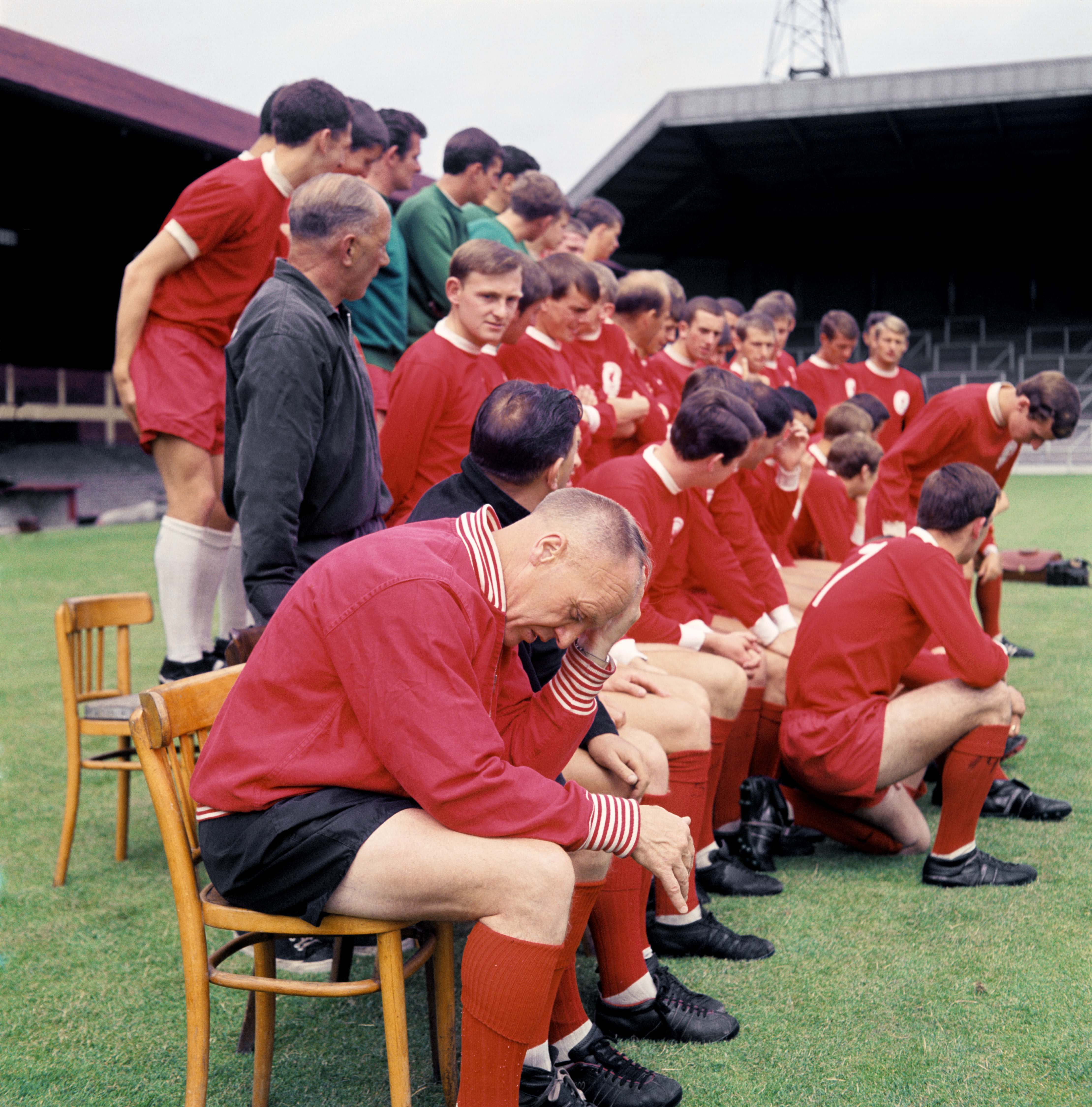 Even Bill Shankly felt the stress of a new season sometimes as the players and coaches gathered for a team group picture. 18/8/1967.