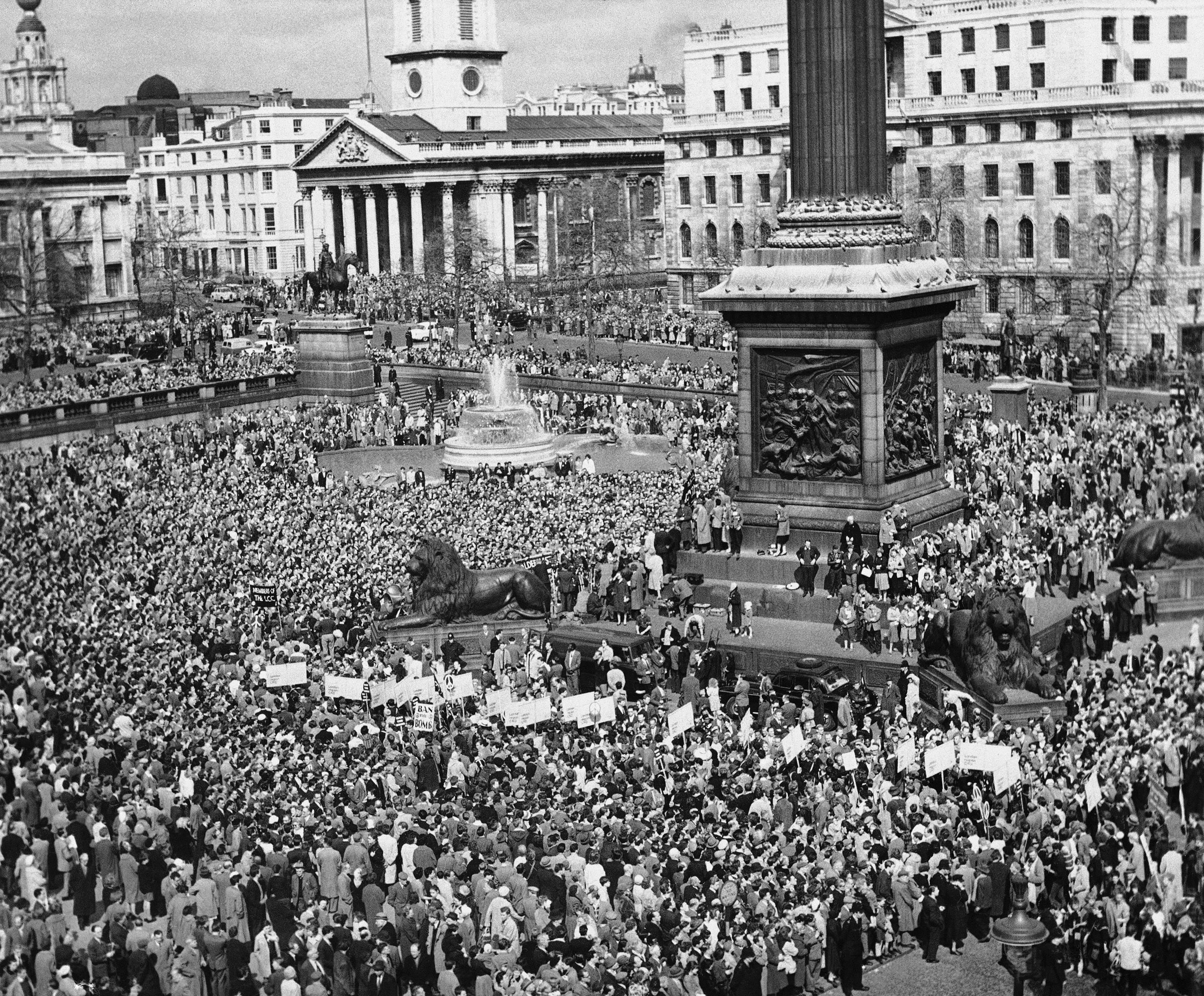 "Nearly 70,000 persons pack in Trafalgar Square, London on April 18, 1960, in demonstration that climaxed four-day ""Ban the Bomb"" march from Aldermaston to the British capital. Aldermaston is British atomic research center."