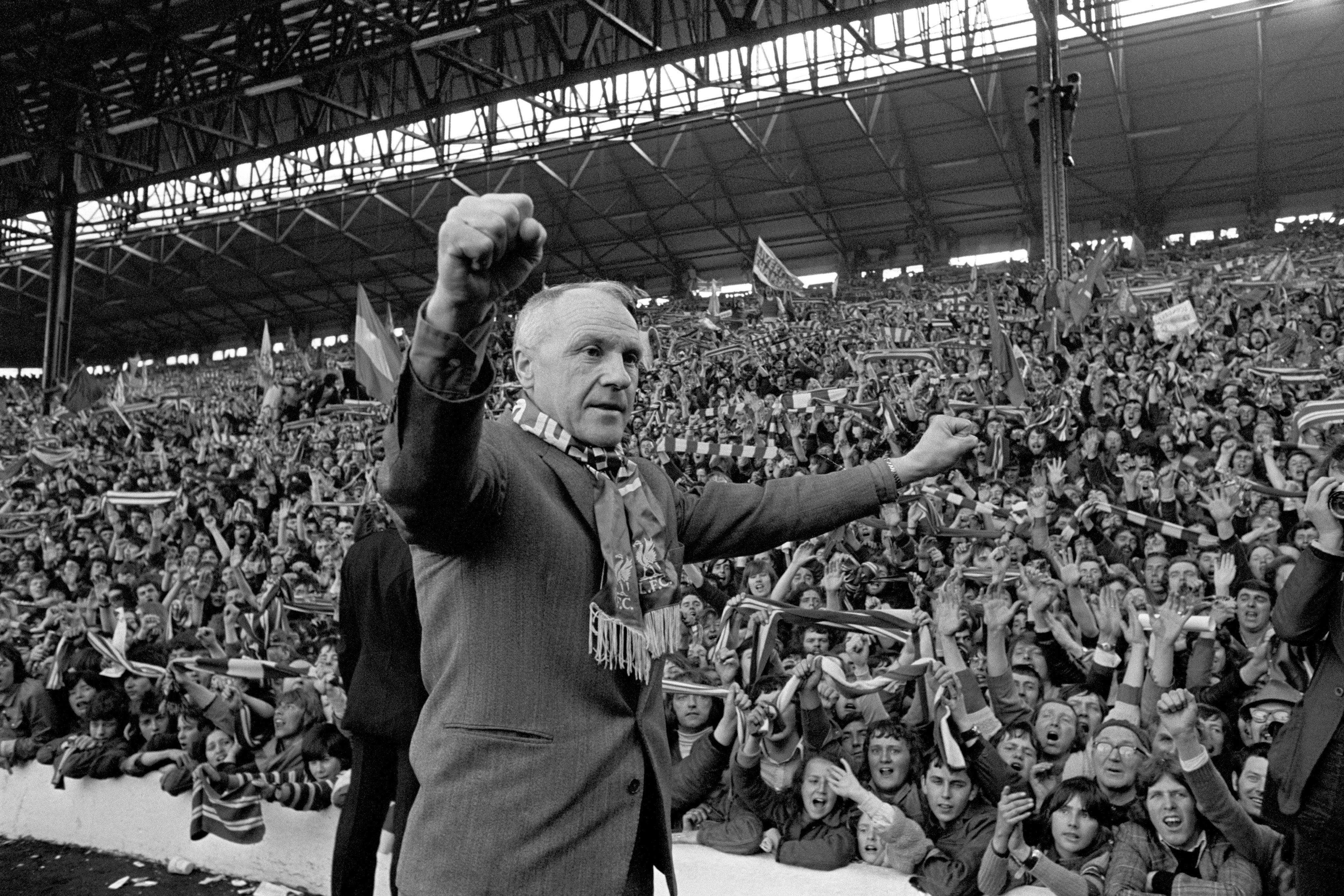 Liverpool's legendary Bill Shankly.  Turning towards the Kop end of Anfield, Shankly gets an ovation from the fans who idolised him when Liverpool became League champions.