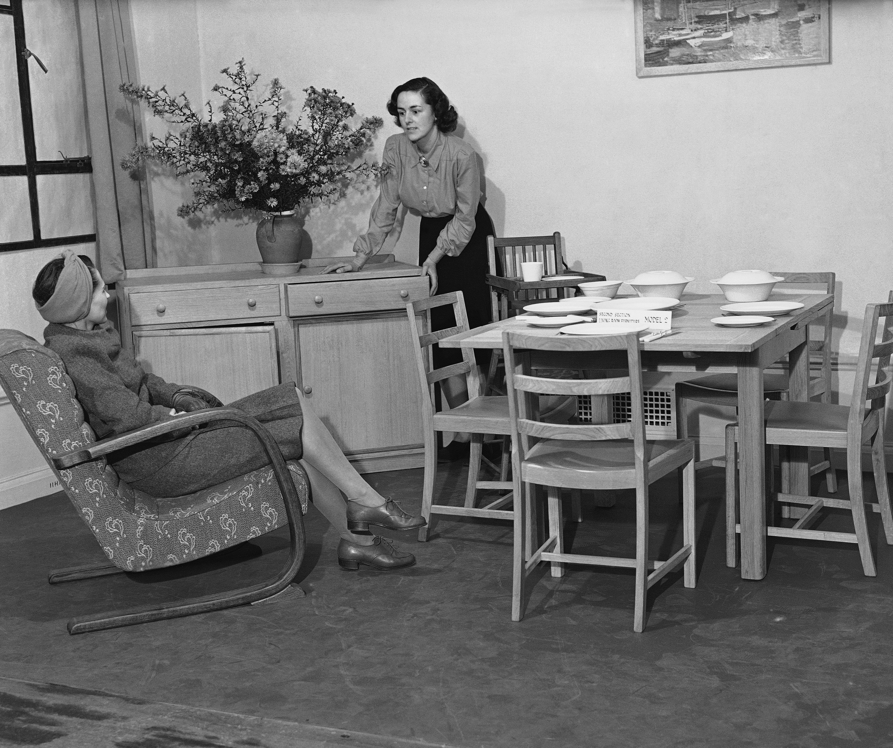 "The first examples of the new utility furniture were shown to the trade in London on Oct. 15, 1942. The show included tables chairs, sideboards and beds. Plywood and all the ""Trimmings"" of peacetime furniture have been cut out. A utility dining-room suite, with his furniture given a light oak finish. (AP Photo)"