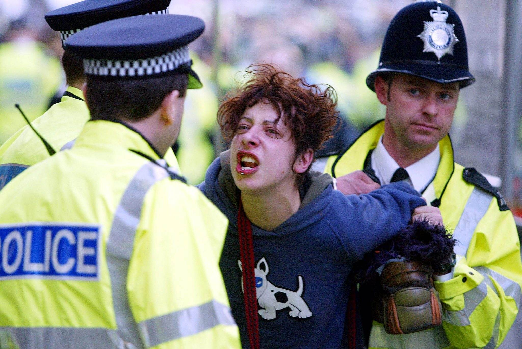 woman is lead away by Police in London's Trafalgar Square, during the annual May Day protests 01/05/2003