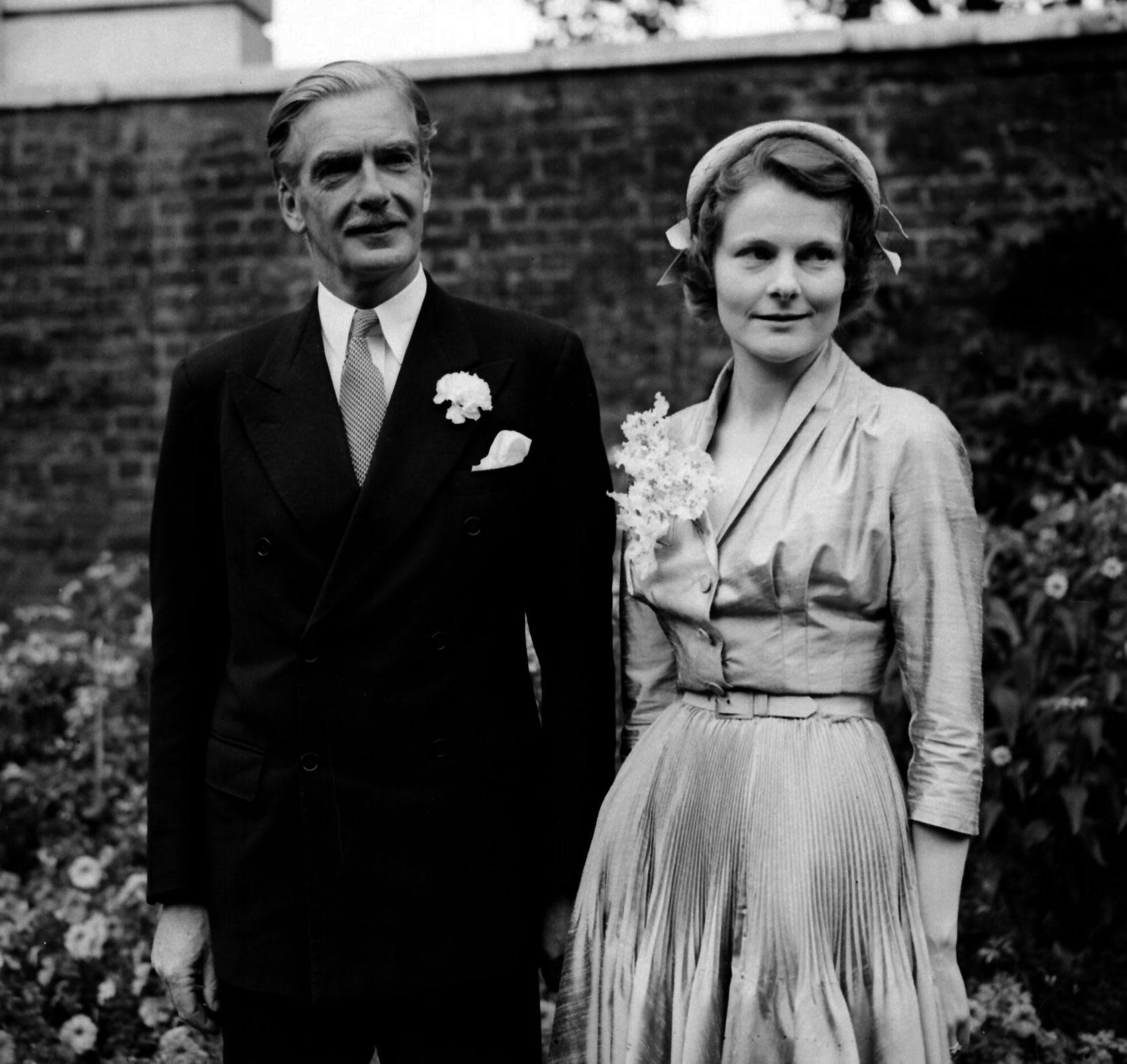 Mr and Mrs Anthony Eden in the garden of No 10 Downing Street after their wedding at Caxton Hall Register Office, Westminster. The Groom is Britain's Foreign Secretary while the Bride, the former Clarissa Spencer Churchill, is the 32 year old niece of Sir Winston Churchill. The marriage survived until Eden's death on 14 January 1977 in Salisbury.