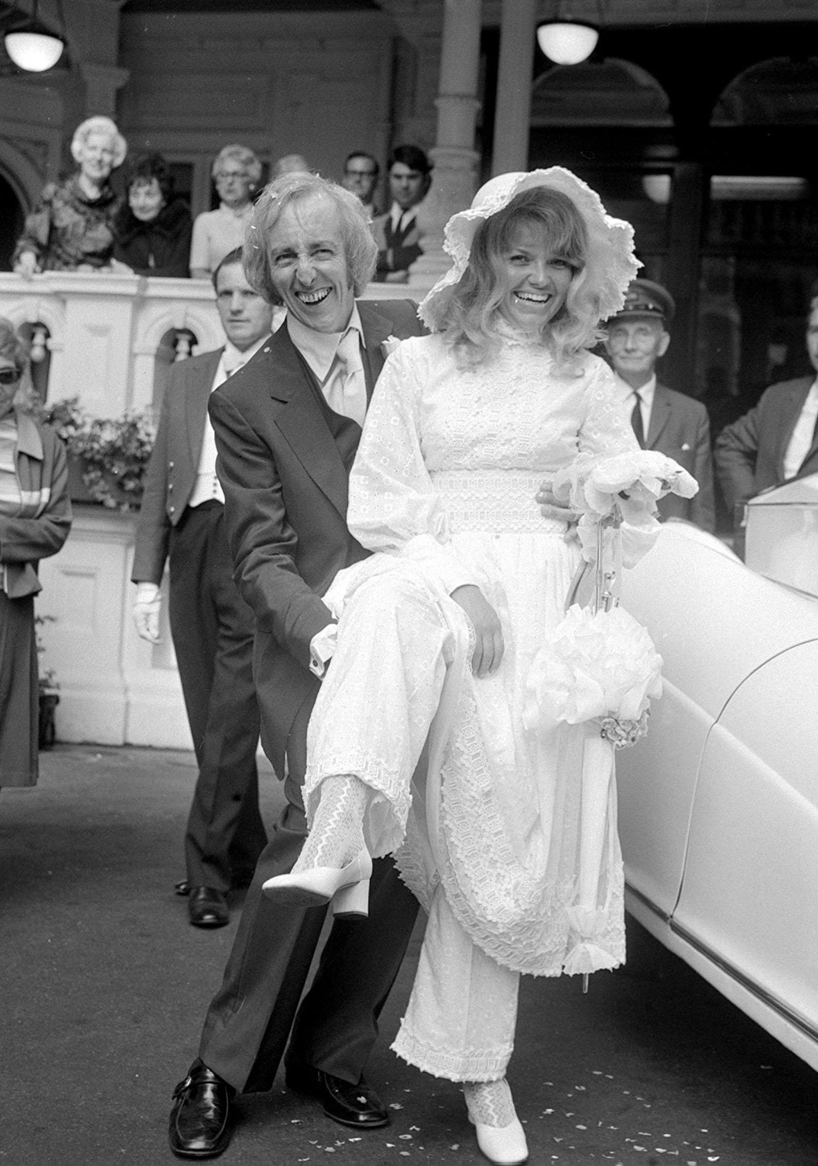 After the wedding at Caxton Hall on 24 August 1970, actor Bob Grant of television's On The Buses and his bride, former Kim Benwell, an ex-Raymond Revue girl, happily showing her old fashioned underwear. They were married until Grant took his own life in 2003.