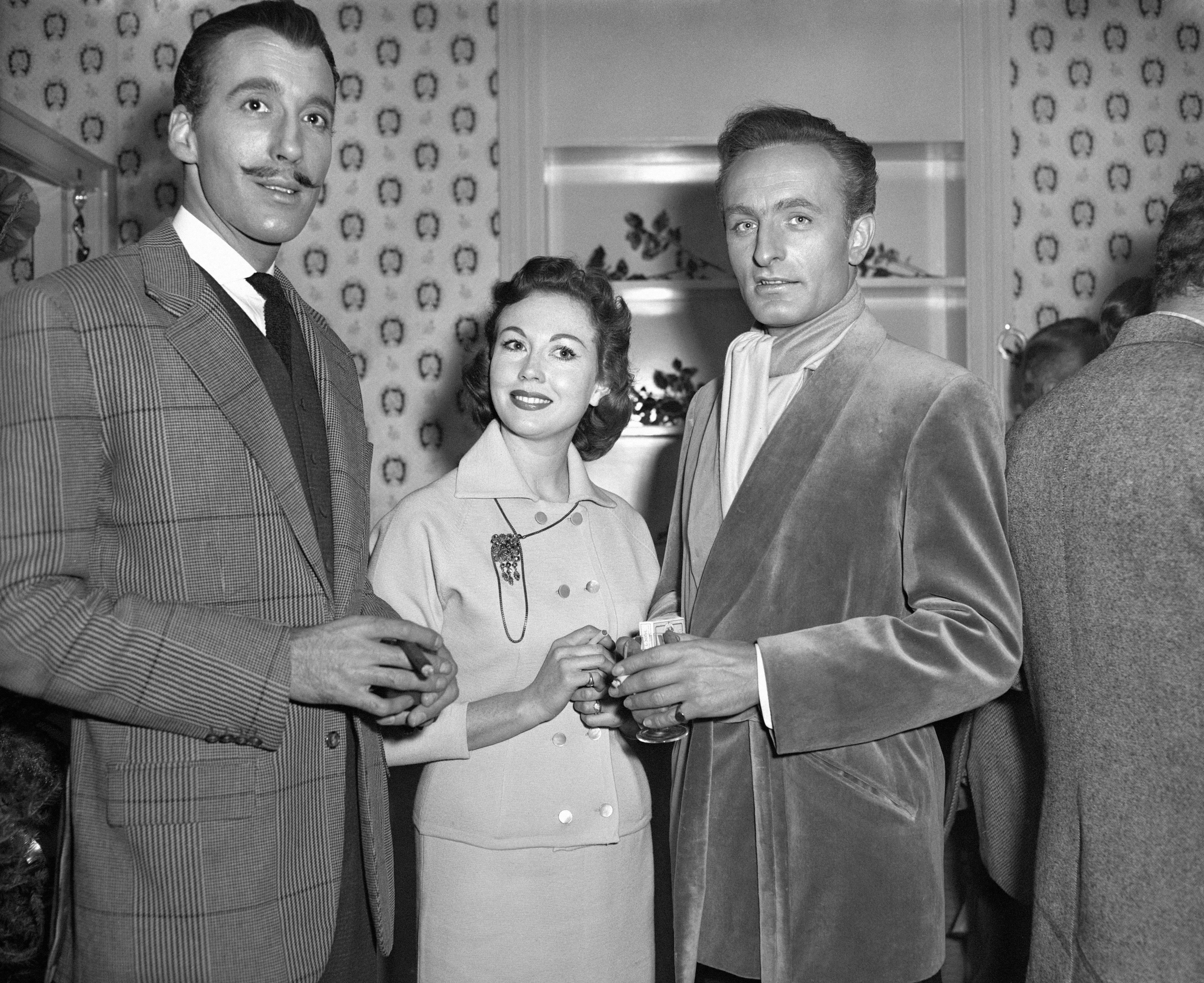 Christopher Lee, Hazel Court and Anton Diffring at the Hammer Christmas party in December 1958