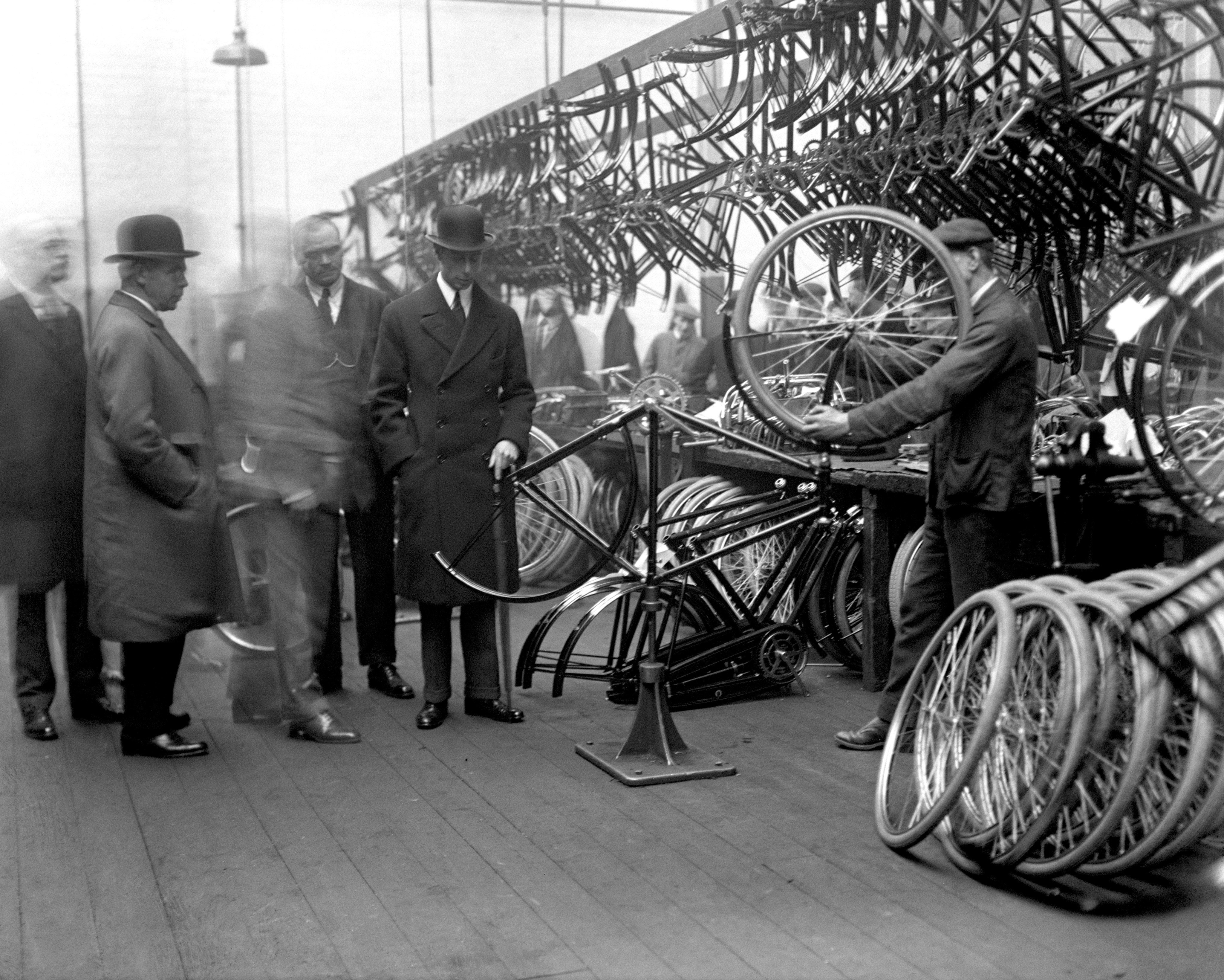 The Duke of York (later to become George VI) watching the assembling of bicycles at the Raleigh factory in Nottingham. From 1929.