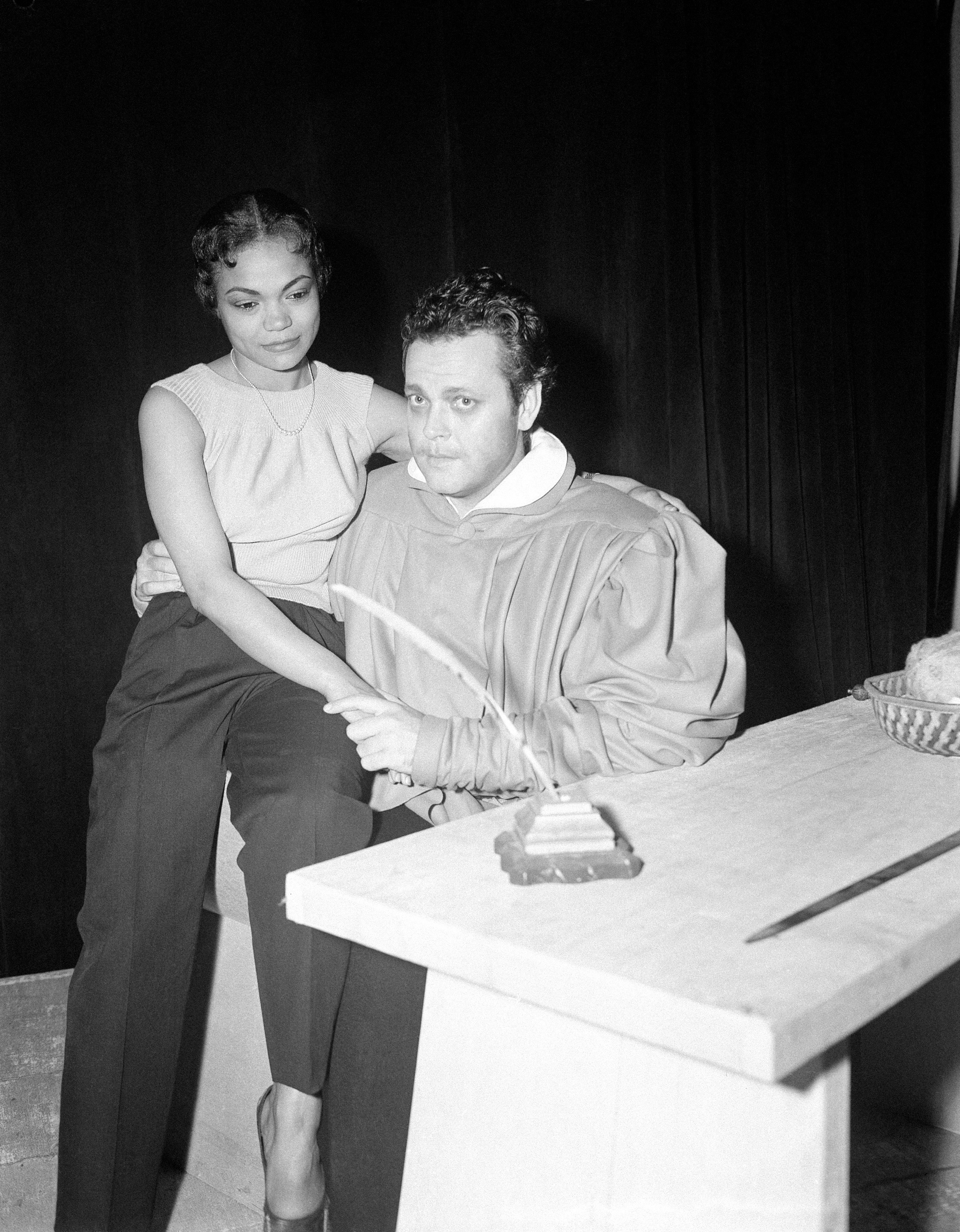 "Orson Welles as Faust rehearses with Eartha Kitt as Helen of Troy at the theatre in Paris on June 14, 1950. Welles is playing the leading role in a play called ""The Blessed and the Damned"" which he wrote himself and which he is directing. (AP Photo/Jean Aubry)"