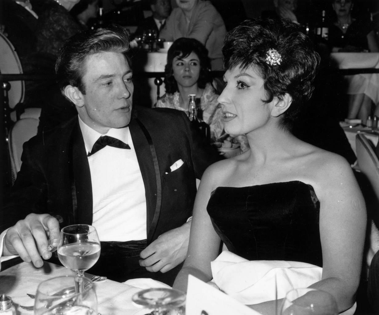 31st January 1961: English actor Albert Finney with the singer Alma Cogan (1932 - 1966) at the 'Talk of the Town' restaurant. (Photo by Evening Standard/Getty Images)