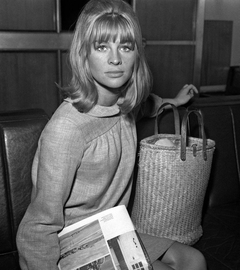Julie Christie at London Airport about to fly to Italy for the final scenes of 'Darling'.