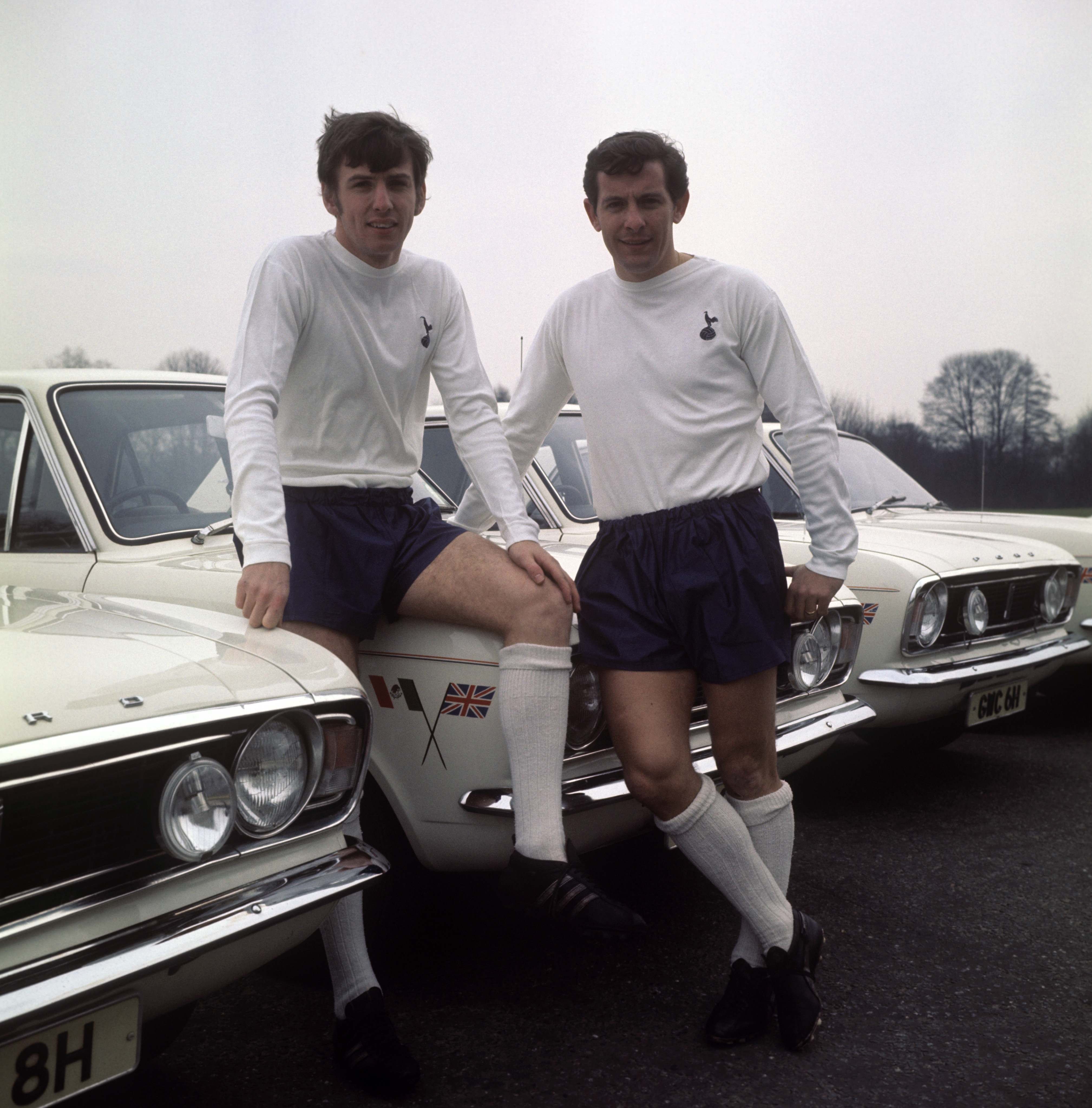 England and Tottenham Hotspur players Martin Peters (left) and Allan Mullery. In 1970 Ford loaned out a Ford Cortina to every England player for a year.