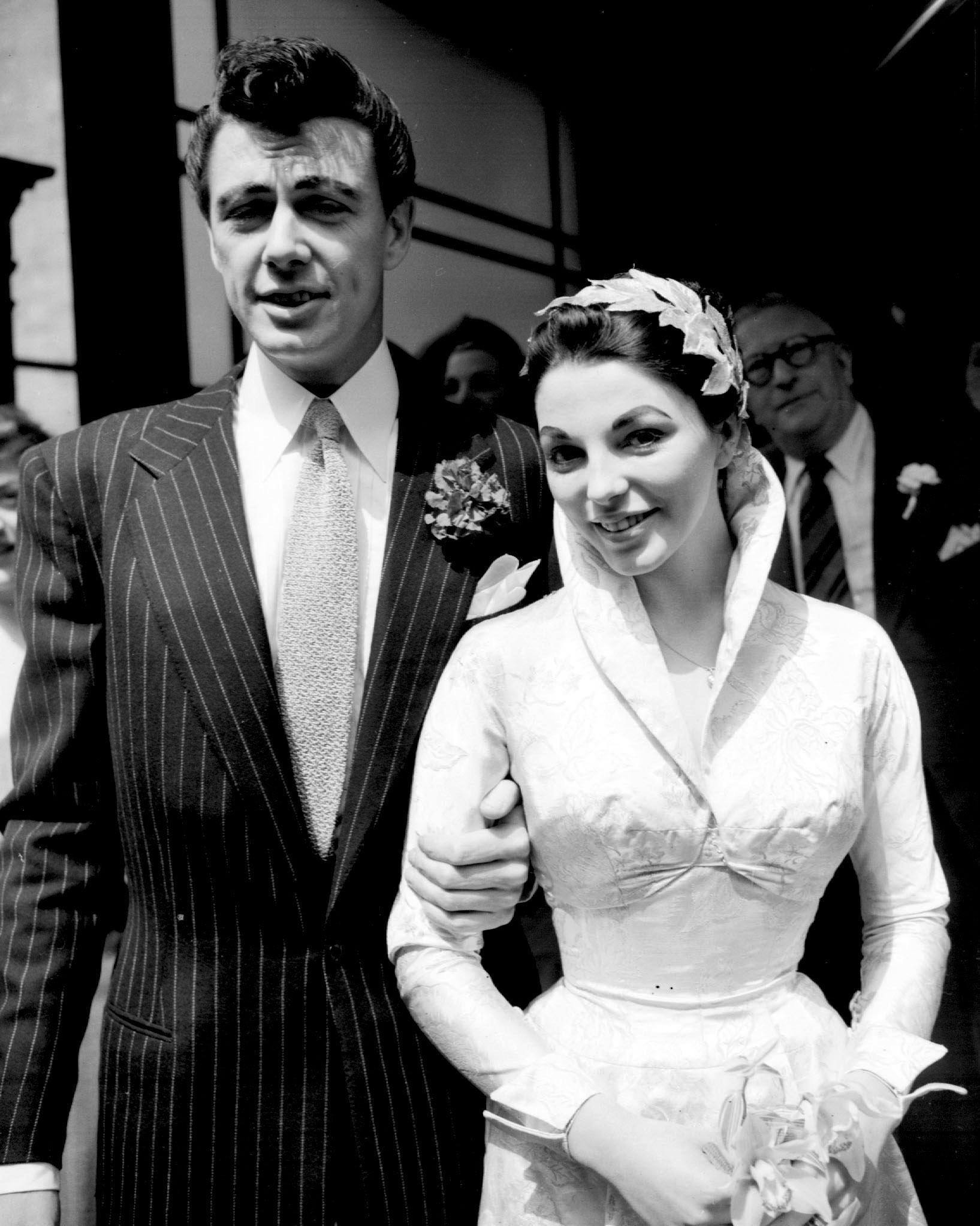 Actor Maxwell Reed and his bride actress Joan Collins after their wedding at Caxton Hall Register Office, London.