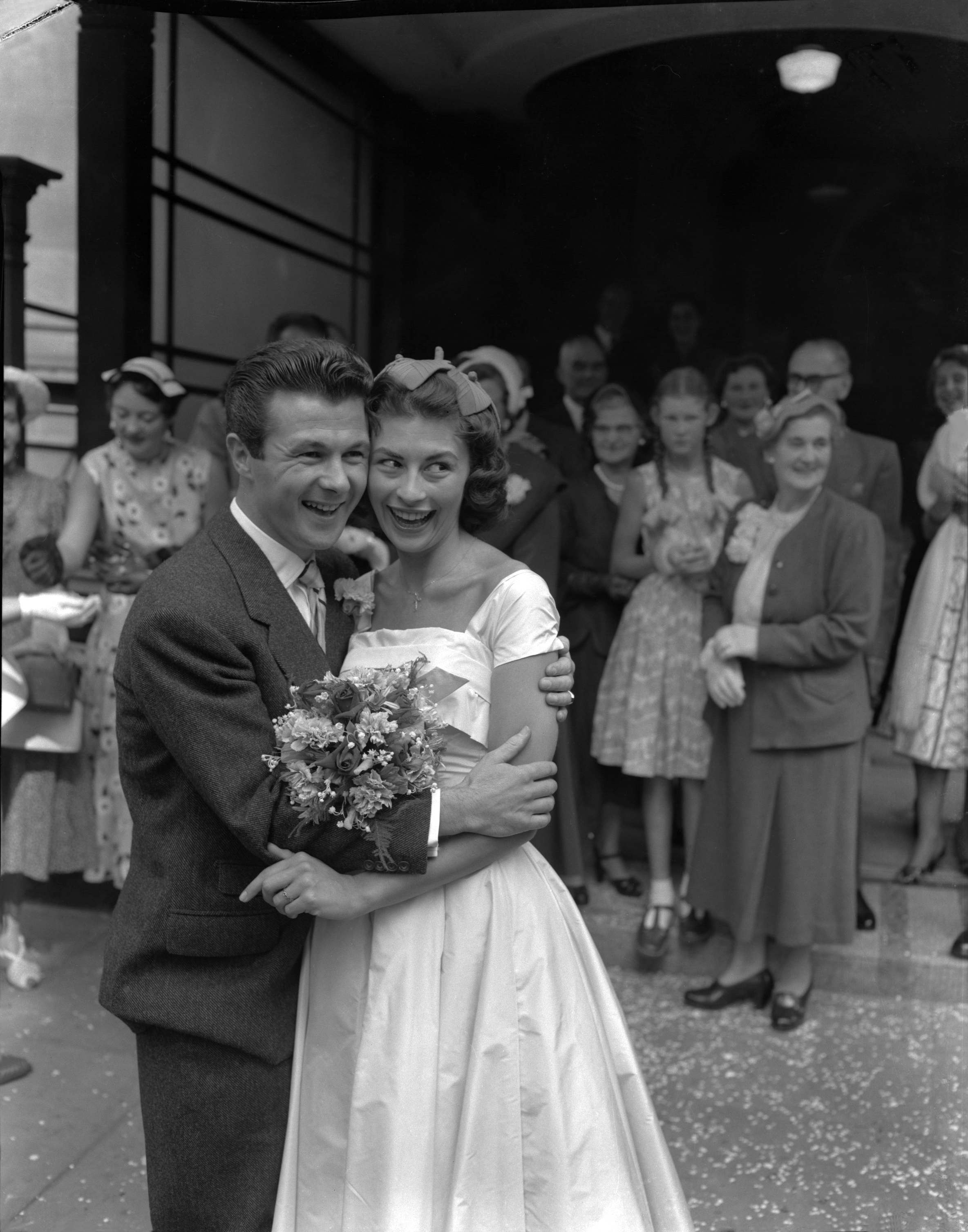 English actress Nanette Newman, 21, and actor-writer Bryan Forbes are shown after their wedding at London's Caxton Hall Register Office, United Kingdom on August 27, 1955. The couple met 18 months ago when Bryan was under a train at London's Marylebone Station; he was playing in a film and Miss Newman was watching. they were married for 58 years, until Forbes' death in 2013. (AP Photo/John Rider)