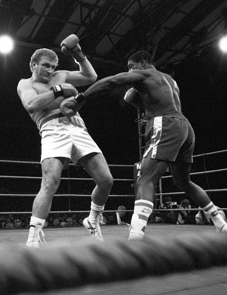 File picture of boxer Joe Bugner (l) in action against Frank Bruno in 1987. Bugner, the former British world heavyweight title contender, has announced he will return to the ring next month at the age of 45. Now a grandfather and Australian citizen, the ex-British and European title holder says he will fight current Australian champion Vince Cervi, 27, on the Gold Coast on September 22. See PA story BOXING Bugner. Ref #: PA.1003947  Date: 23/08/1995