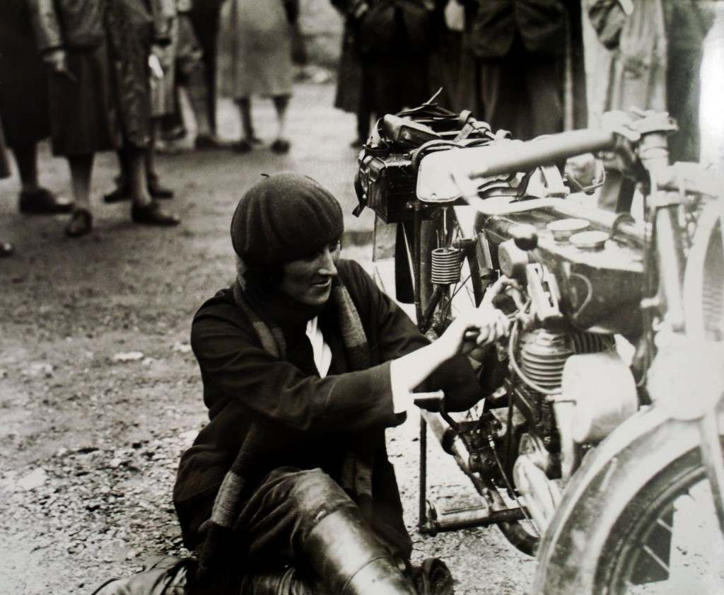 Marjorie Cottle putting finishing touches on her motorcycle Ref #: PA.10663315  Date: 07/08/1926