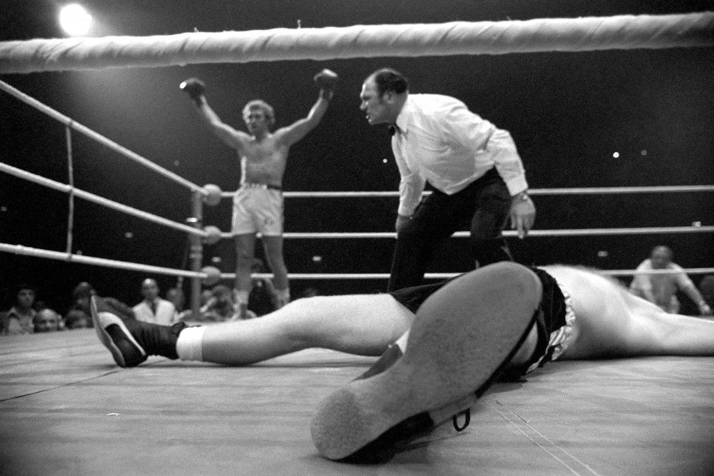 Boxing - European, Commonwealth and British Heavyweight Title - Joe Bugner v Richard Dunn - Empire Pool, Wembley Joe Bugner raises his arm in victory after flooring Richard Dunn in the first round at the Empire Pool, Wembley, London. Ref #: PA.1149397  Date: 12/10/1976 Picture by: PA/PA Archive/Press Asso