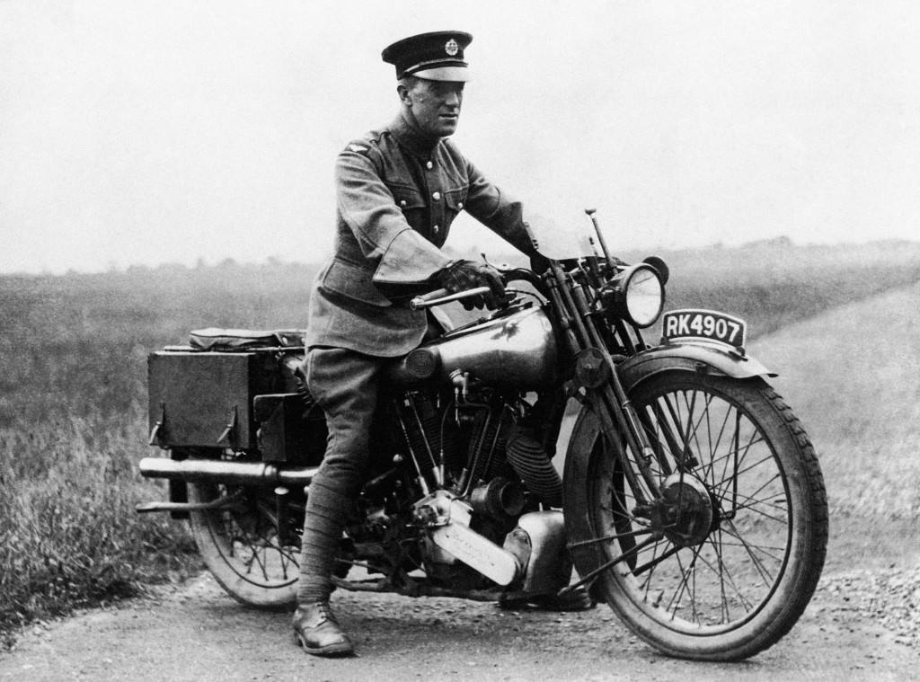 Aircraftsman Thomas Edward Shaw on his motorcycle; a Brough Superior SS100. Shaw was better known as Lt Col T.E. Lawrence or 'Lawrence of Arabia' A major factor in the Desert War in WWI, he was also an adviser to Prince Faisal during the Versailles Peace Conference, a renowned author and an archaeolgist. He was killed in a motorcycle accident in 1935. Ref #: PA.1180096  Date: 26/03/1927