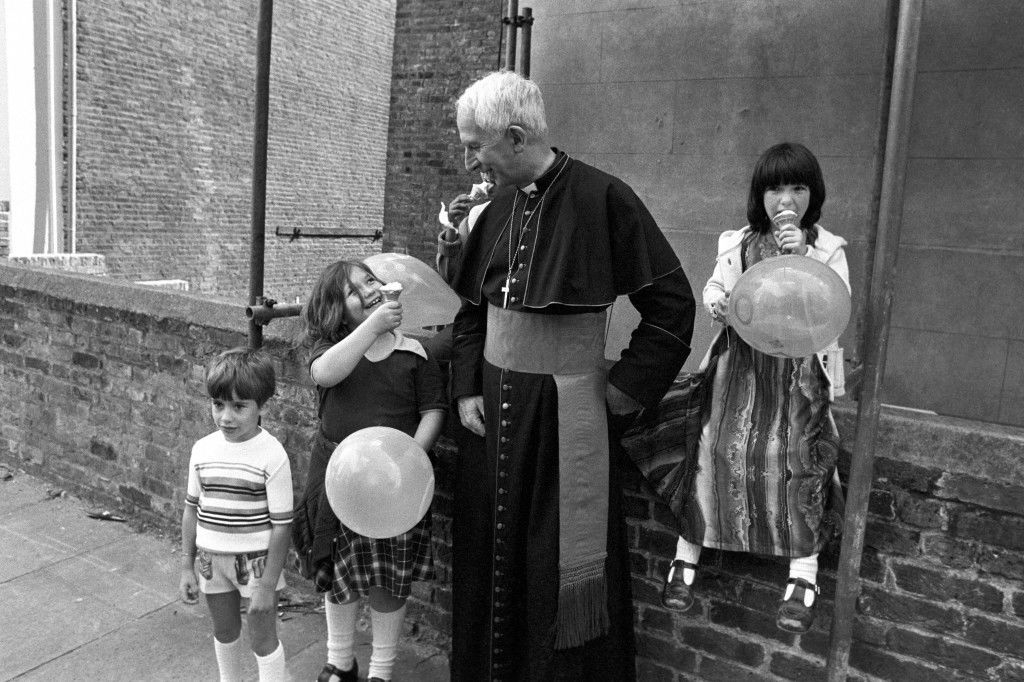 Hume/Notting Hill Carnival Cardinal Hume, Archbishop of Westminster, with eight year old Simone Parrish (L) at the Notting Hill Carnival. Cardinal Hume was attending an open air service at a church in the heart of the carnival area. Ref #: PA.1199244  Date: 26/08/1979