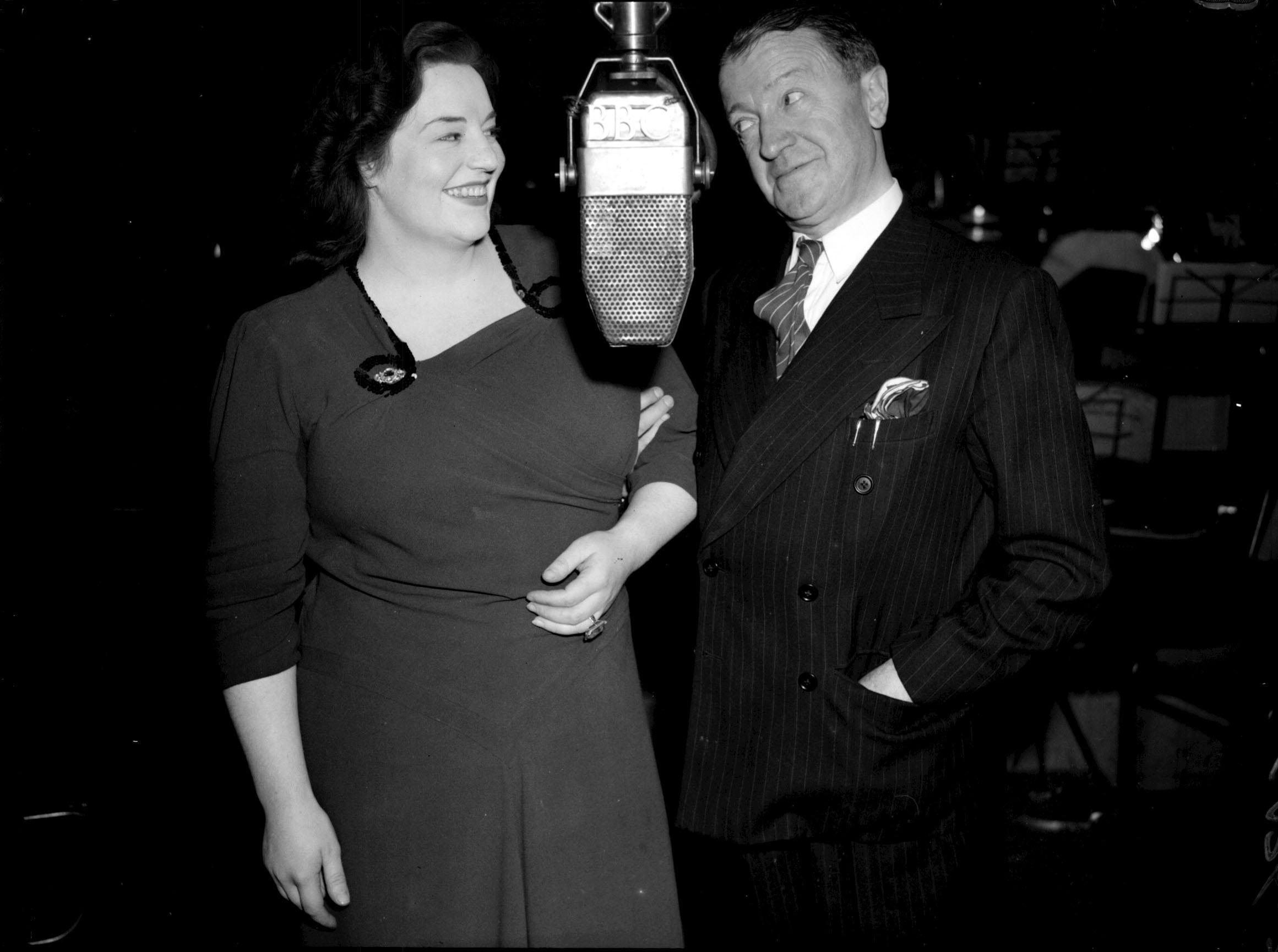 "Tommy Handley and Hattie Jackes, during rehearsals for the radio show ""Itma"" in London 25/9/47"
