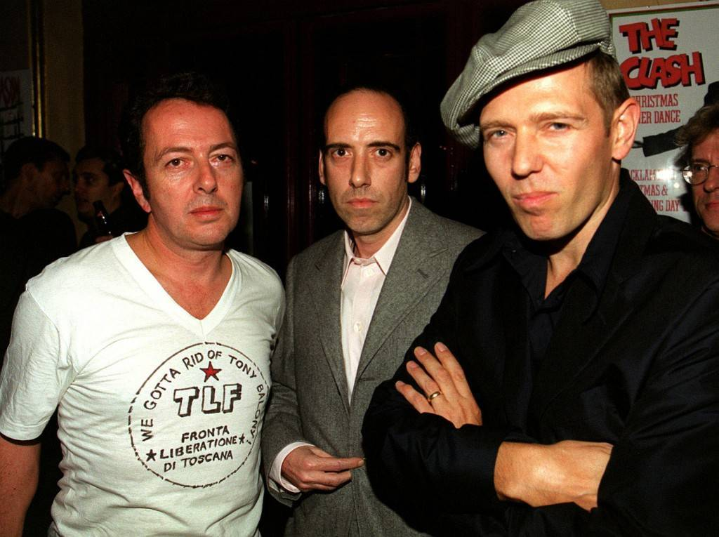 "Three members of The Clash (from left), Joe Strummer, Mick Jones and Paul Simonon at the premiere of the BBC2 documentary ""Westway To The World"" in Notting Hill in London. The film is about the career of the band, who split in 1986. Ref #: PA.1228647  Date: 21/09/1999"