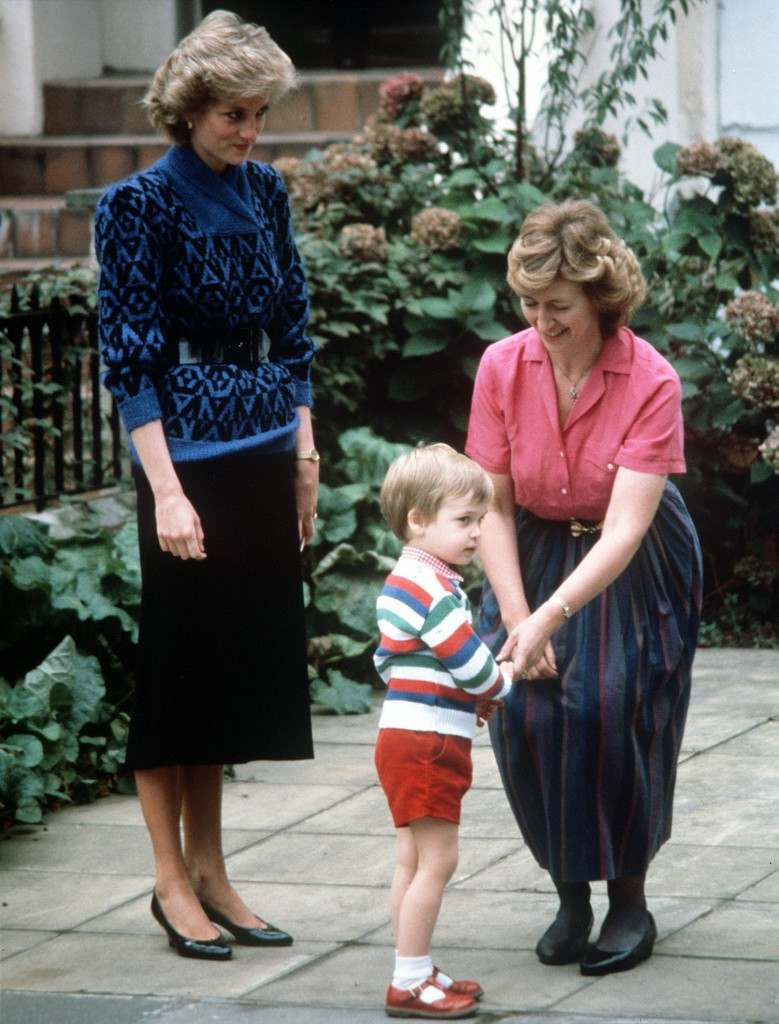 Diana, The Princess of Wales looks on as Mrs. Jane Mynors greets Prince William at the Victorian terrace house on his first day at Jane Mynors nursery school in London Ref #: PA.1233465  Date: 24/09/1985