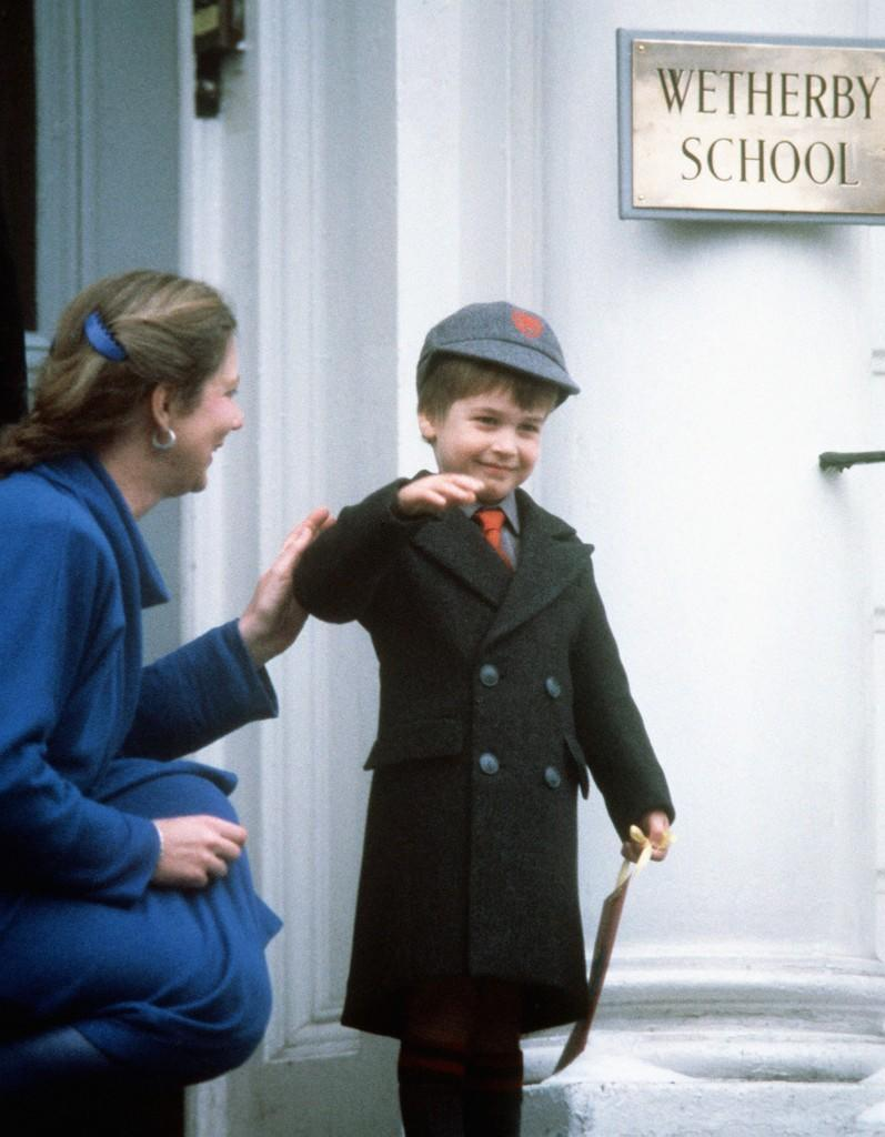 "Prince William waves at onlookers after his first day at his new school, ""Wetherby School"" in Notting Hill Gate, London. Ref #: PA.1233794  Date: 15/01/1987"