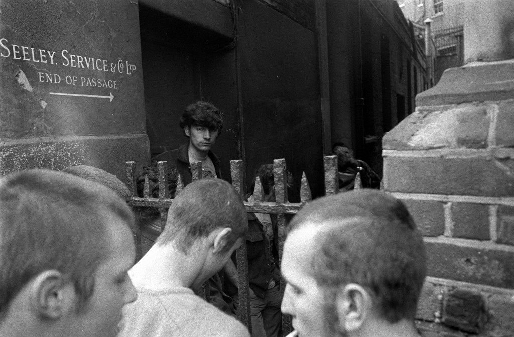 A confrontation over the railings between Skinheads and Hippies at the Endell Street School, London. The owners of the school were granted a possession order for the school, which had been taken over by squatters. Date: 24/09/1969