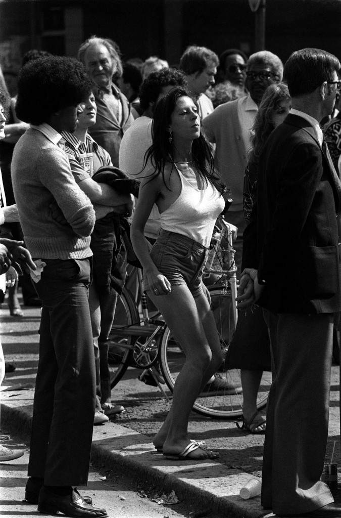 Dancing at the Notting Hill Carnival Her body swaying to the music of a reggae band, this sultry lady enjoys the Notting Hill Carnival, oblivious to the crowd around her. Ref #: PA.1326915  Date: 25/08/1980