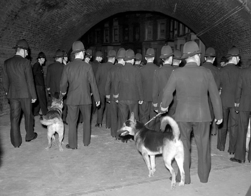 British Crime - Riots - Notting Hill Race Riots - London - 1958 Police officers with dogs at a street in London's Notting Hill area, during renewed race rioting between whites and blacks which broke out the previous night. Ref #: PA.1330824  Date: 01/09/1958