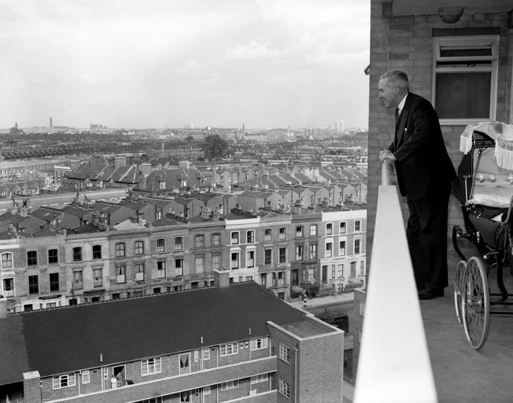 British Politics - The Conservative Party - Henry Brooke - London - 1959 From the 10th floor of a new block of flats in Treverton St, Notting Hill, Housing Minister Henry Brooke gets a magnificent view over London. He was inspecting progress in rehousing and slum clearance in Finsbury, Bethnal Green and Kensington. Ref #: PA.1416215  Date: 10/06/1959