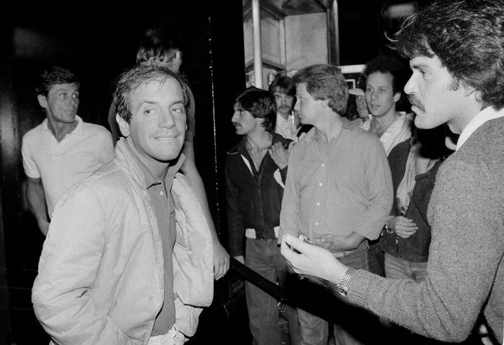 Studio 54 co-owner Steve Rubell, second from left, works the line at the door as co-owner Ian Schrager, left, watches outside the disco, June 26, 1979, New York. (AP Photo/Richard Drew)