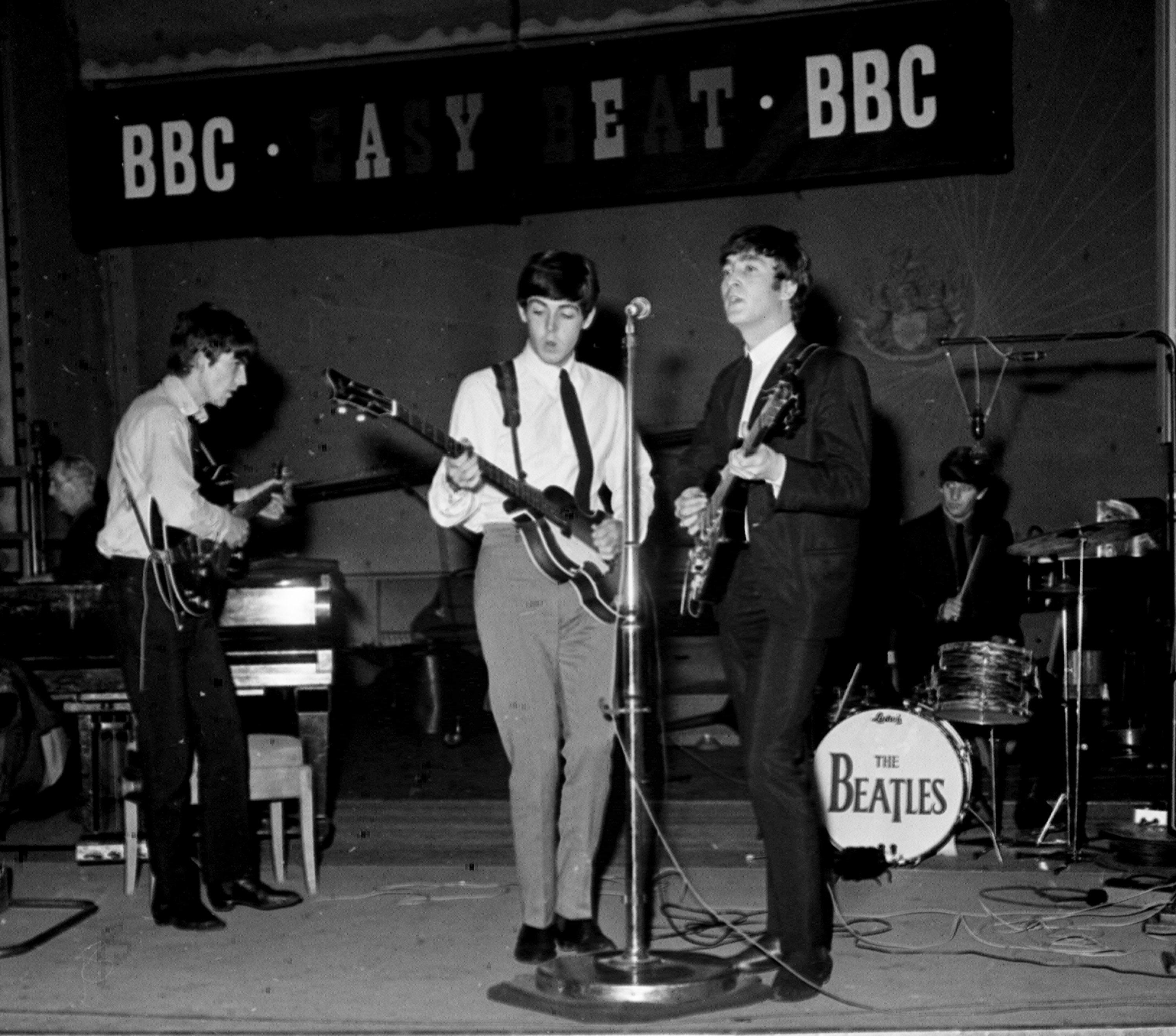 The Beatles singing together during a recording session for the BBC radio programme 'Easy Beat'   10/10/1963