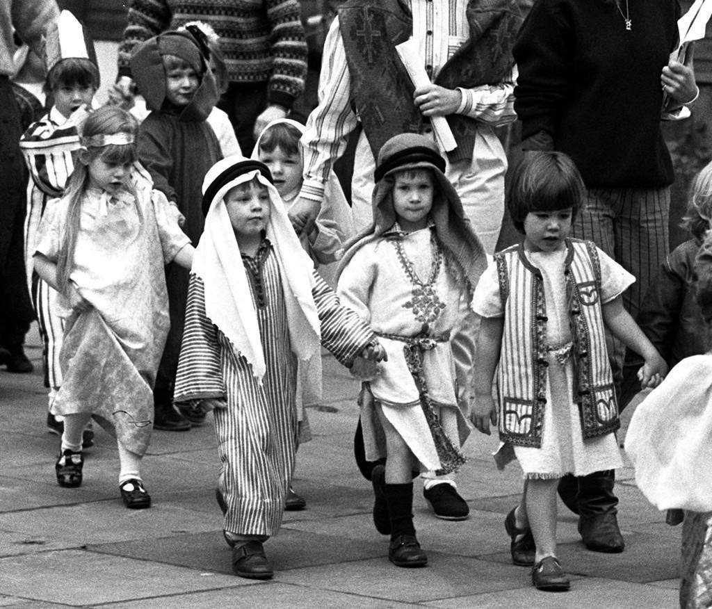 Four year old Prince Harry, youngest son of the Prince and Princess of Wales, holds hands with a fellow shepherd boy as they arrive at their kindergarten to act in a nativity play. Prince Harry donned embroidered robes for his part as a shepherd boy at the Jane Mynors school in Notting Hill. Ref #: PA.1618761  Date: 08/12/1988