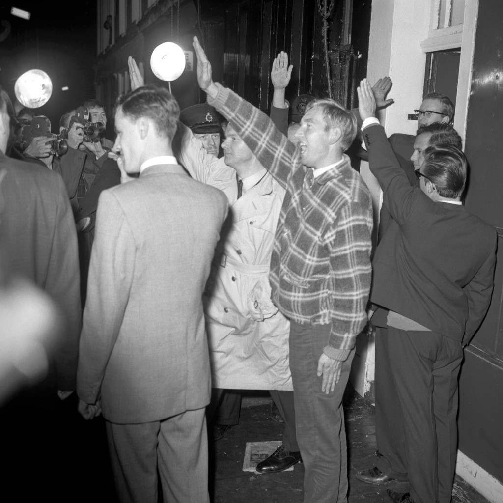 Politics - British National Socialist Movement - Notting Hill, London Nazi salutes from Colin Jordan, leader of the British National Socialist Movement (centre, white coat), and some of his followers as he leaves his Notting Hill headquarters in London after taking part with his wife, Francoise Dior (not pictured), in an old Nordic 'Blood-letting' ceremony following their wedding at Coventry register office. Archive-pa105659-8 Ref #: PA.16213979  Date: 08/10/1963